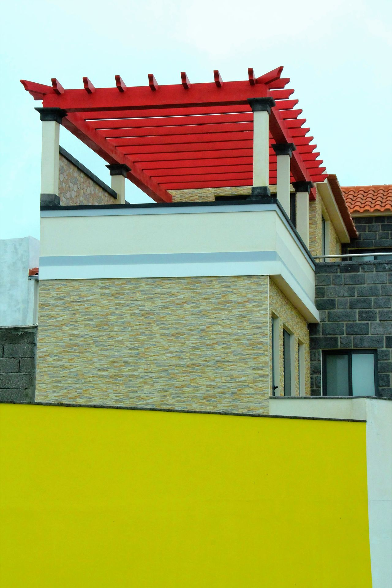 Architecture Building Exterior Built Structure Cloud - Sky Contrasts Day Exterior High Section In Front Of Modern Architecture Multi Colored No People Outside Pergola Red Restaurant Sky Vibrant Color Window Wooden Yellow TakeoverContrast