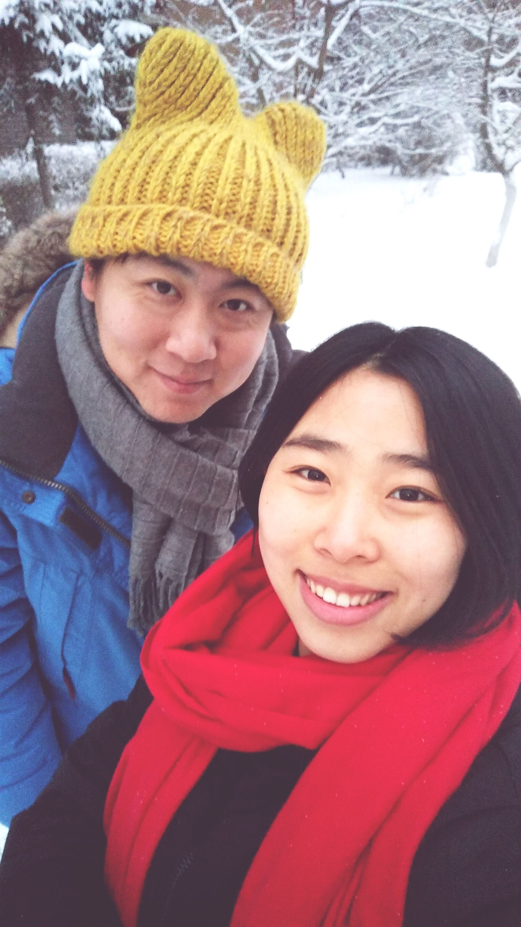 two people, winter, cold temperature, knit hat, lifestyles, couple - relationship, red, warm clothing, snow, love, heterosexual couple, togetherness, young adult, women, young women, smiling, bonding, real people, portrait, happiness, close-up, outdoors, men, cheerful, people, nature, adult, adults only, day