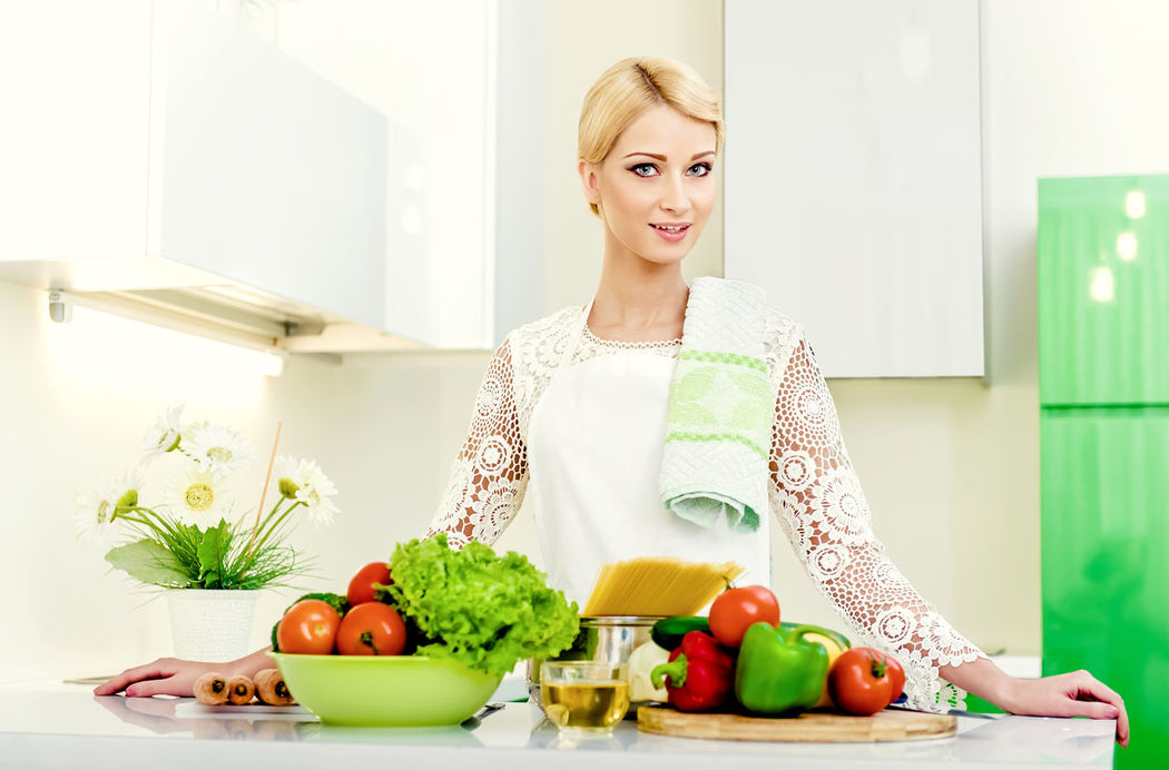 Young woman in the kitchen.Healthy Food. Dieting Concept. Healthy Lifestyle. Cooking At Home. Apron Attractive Beautiful Woman Blonde Girl Cheerful Cooking At Home Diet Food Fresh Girl Healthy Eating Healthy Food Healthy Lifestyle Home Housewife Ingredients Kitchen Pasta People Preparing Food Smiling Spaghetti Vegetables Vegetarian Food Woman Young Women