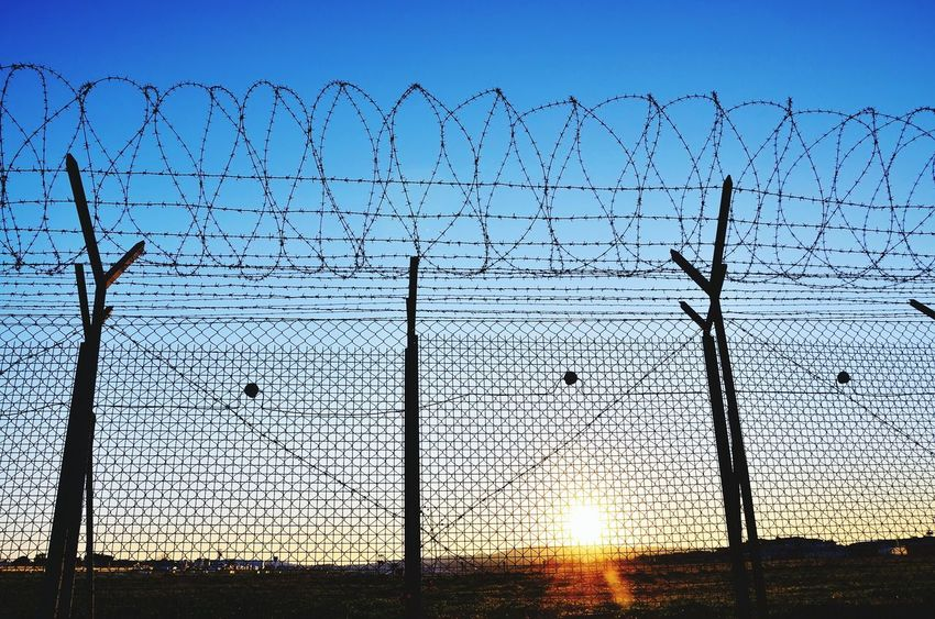 Sky No People Silhouette Outdoors Barbed Wire Wire Fence Concept Emigration Barbedwirefence Barbed Wire Sunset Security Prision Emigrating Emigrant Hill Isolation Security Fence Bared Wire