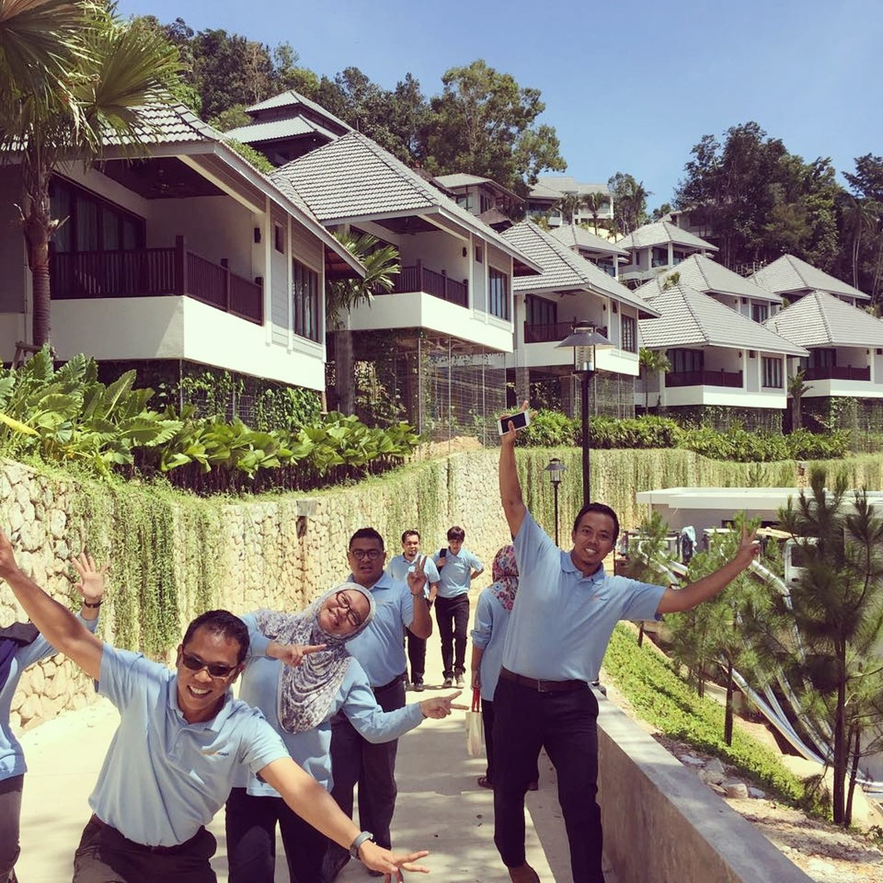 smiling, arms raised, architecture, built structure, enjoyment, happiness, building exterior, house, day, real people, fun, lifestyles, outdoors, leisure activity, cheerful, young adult, looking at camera, togetherness, tree, young women, portrait, friendship
