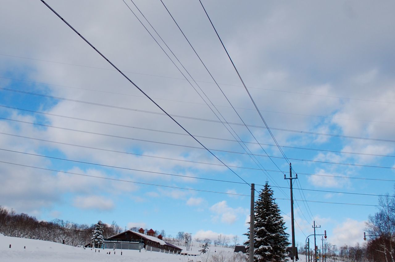 cable, sky, power line, cloud - sky, low angle view, connection, power supply, no people, day, electricity, electricity pylon, outdoors, tree, nature, winter, built structure, building exterior, architecture, beauty in nature, technology, telephone line