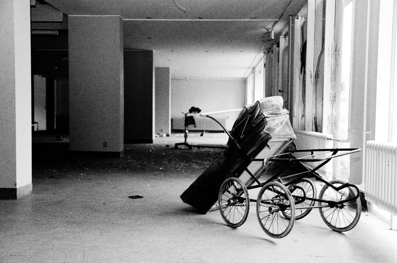 indoors, bicycle, real people, men, one person, built structure, architecture, full length, wheelchair, women, day, hospital, adult, people