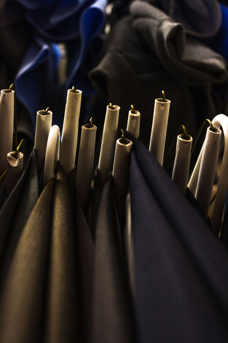 Black Pants Business Attire Businessman Button Up Shirt Dress For Success Hangers Hanging Clothes Hanging Clothing Khaki Pants Looking Up Slacks Suit Up Beautifully Organized