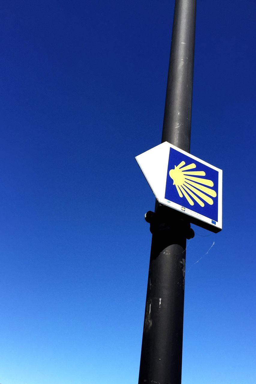 blue, guidance, road sign, communication, copy space, direction, clear sky, low angle view, day, no people, outdoors, close-up