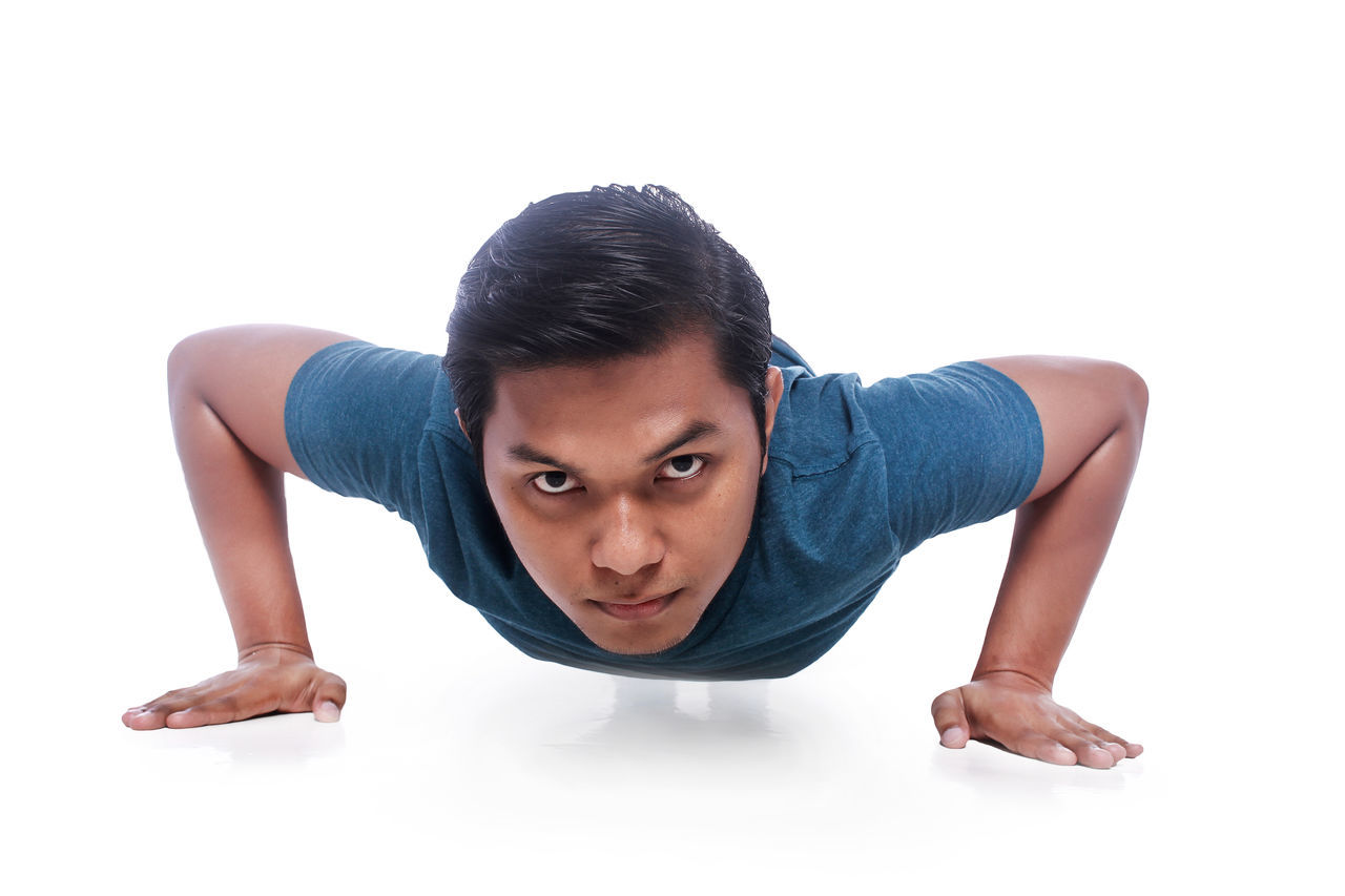 young man doing exercise routine isolated in whitebackground Blue Challenge Exercise Healthy Healthy Lifestyle Jogging Jumping Person Pose Pumping Sit Up Sport Sportwear Squat Thropy White Background Young Adult Young Man