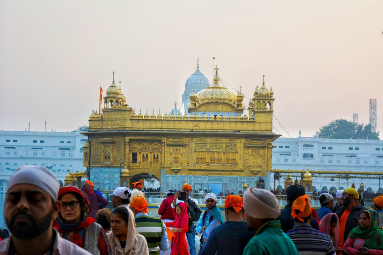 Over 100,000 people visit the holy shrine daily for worship, and also partake jointly in the free community kitchen and meal. Harmandir Sahib is house of the world's largest soup kitchen. According to Croatian Times, it can serve free food for up to 100,000 - 300,000 people every day. At the Langar (Kitchen), food is served to all visitors regardless of faith, religion, or background. To take care of such huge number of people everyday lot of man power is required and The most Beautiful thing is most of the people who work in golden temple, work out of faith with no remunerations. Golden Temple Harmandir Sahib Amritsar Golden Gold Riligion Sikhism Gurudwara Gurdwara Sprituality Spritual God Exceptional Photographs Hinduism Place Of Worship Architecture Large Group Of People Built Structure Travel Destinations Building Exterior People Dome Buliding Crowd Enjoying Life