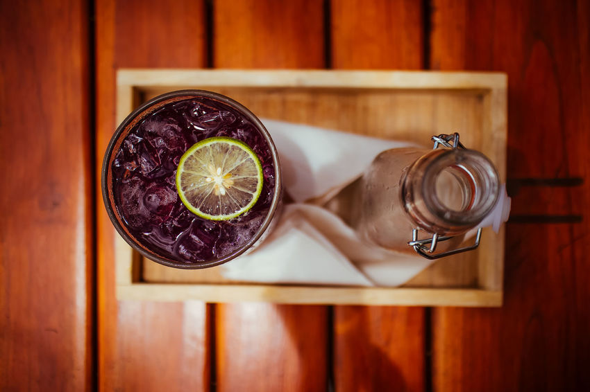 Butterfly pea with lime juice, cold drink. From top view Cool Herb Ice Thai Thailand Butterfly Pea Drink Close-up Drink Focus On Foreground Food Food And Drink Fresh Freshness Fruit Healthy Healthy Eating Indoors  Lemon Summer Sweet Table Top View Water Wood - Material