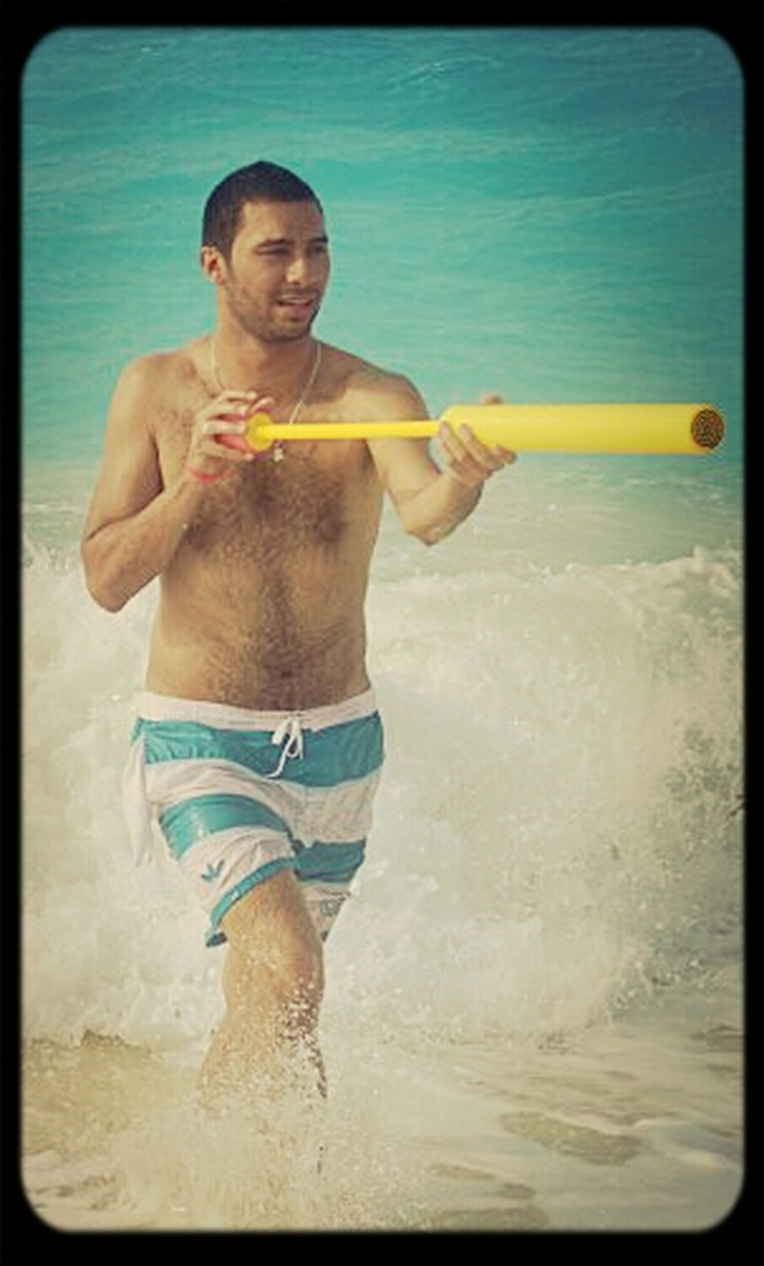 transfer print, water, beach, sea, lifestyles, leisure activity, auto post production filter, person, sand, shore, full length, childhood, elementary age, vacations, horizon over water, boys, casual clothing, shirtless