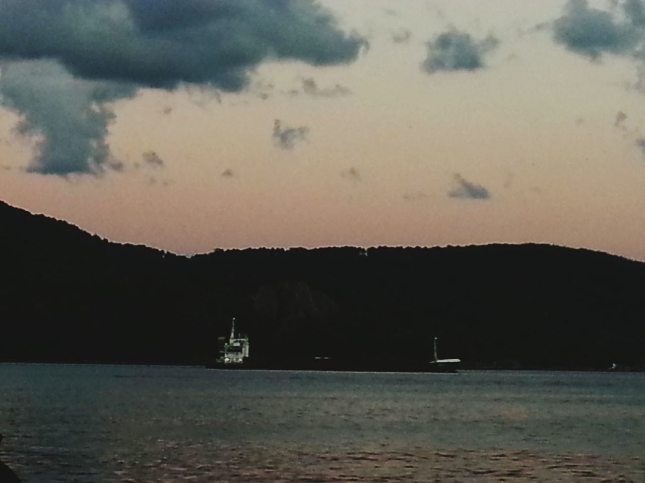 Water Waterfront Mountain Nautical Vessel Sea Tranquil Scene Tranquility Scenics Transportation Boat Sky Cloud - Sky Beauty In Nature Nature Tourism Non-urban Scene Mountain Range Ship Calm Sailing