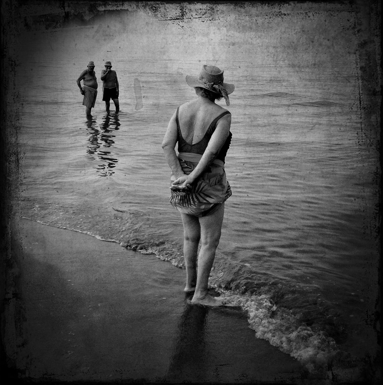 water, real people, full length, rear view, walking, standing, outdoors, men, ankle deep in water, day, two people, lake, togetherness, nature, adult, people