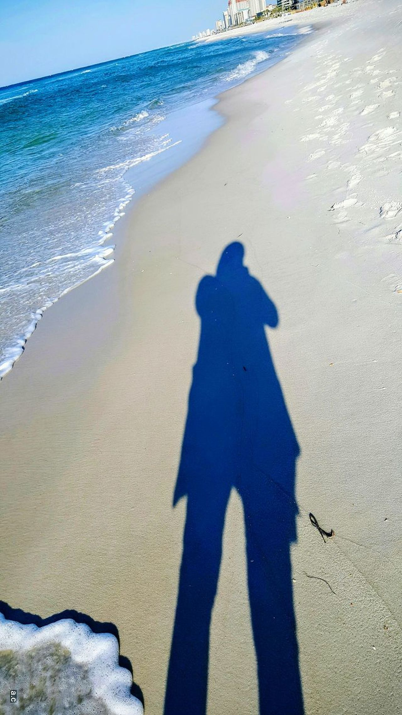 Beach Sea Shadow Sand Focus On Shadow Real People Sunlight Lifestyles Water Men Outdoors High Angle View Day Leisure Activity One Person Wave Nature Motion Only Men Adults Only