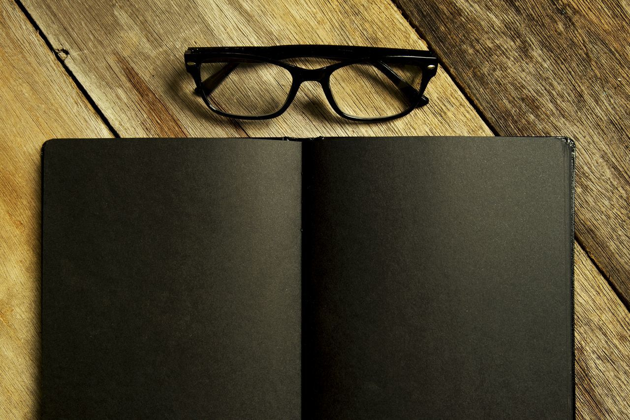 Book and glasses on wooden background Eyeglasses  Sunglasses Eyewear Reading Glasses Book Cover Vintage Table Lifestyle Copy Space Rustic Background Wooden Eyesight Book Indoors  Frame Design