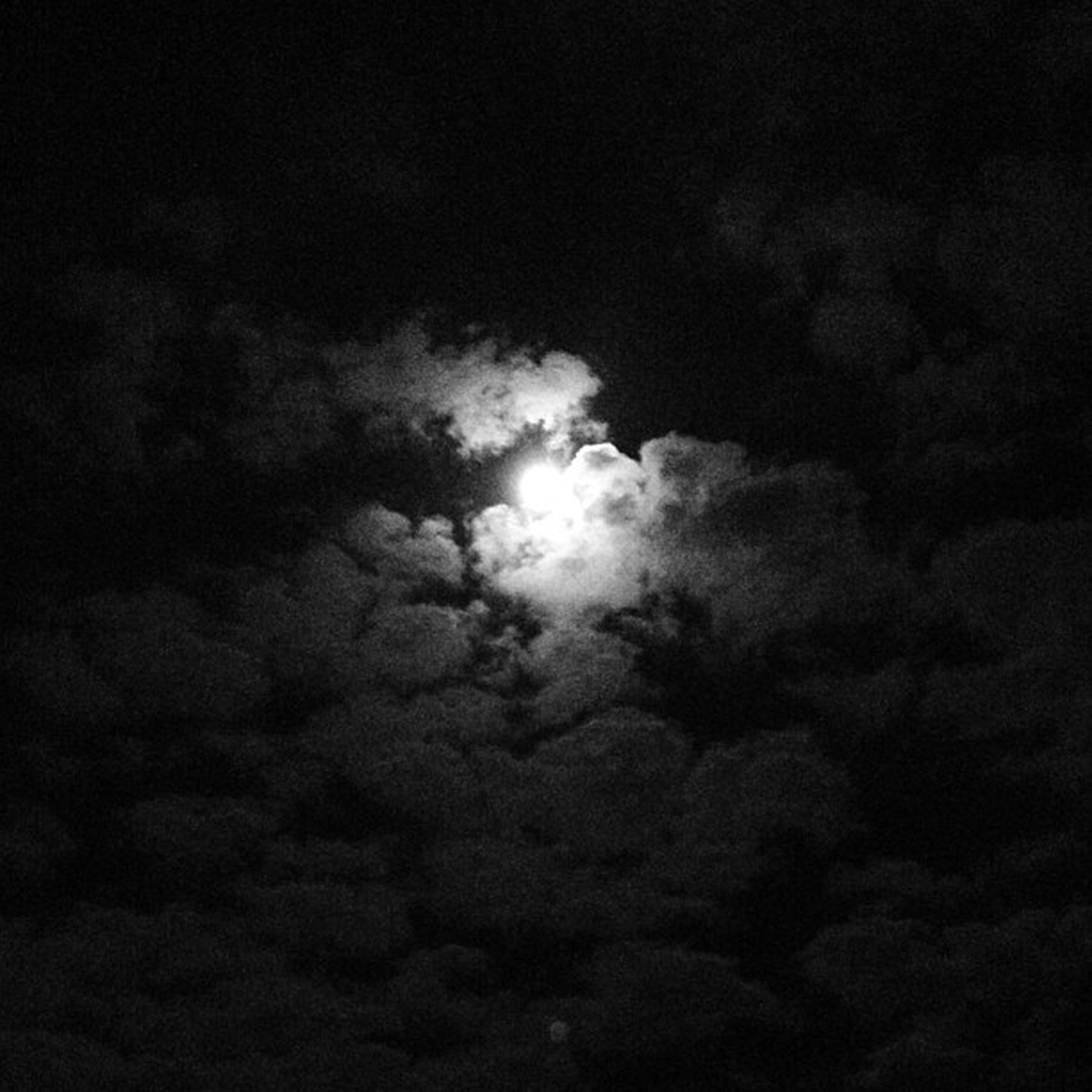 sky, low angle view, cloud - sky, beauty in nature, tranquility, scenics, cloudy, sky only, tranquil scene, nature, weather, cloudscape, backgrounds, overcast, idyllic, cloud, night, majestic, dark, outdoors