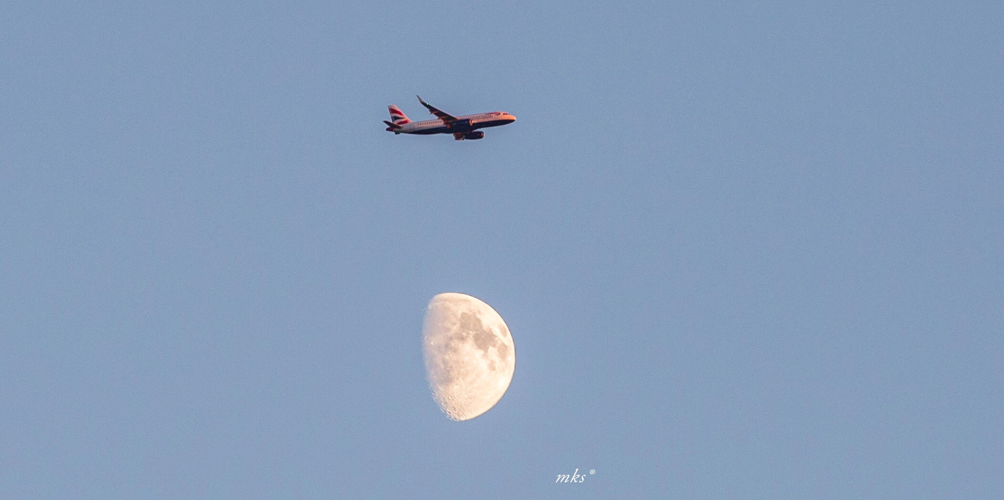 low angle view, transportation, moon, mode of transport, flying, airplane, clear sky, scenics, blue, copy space, air vehicle, tranquility, tranquil scene, beauty in nature, travel, journey, nature, sky, majestic, mid-air, vapor trail, exploration, day, outdoors, space exploration, no people, heaven, dreamlike, vibrant color, romantic sky
