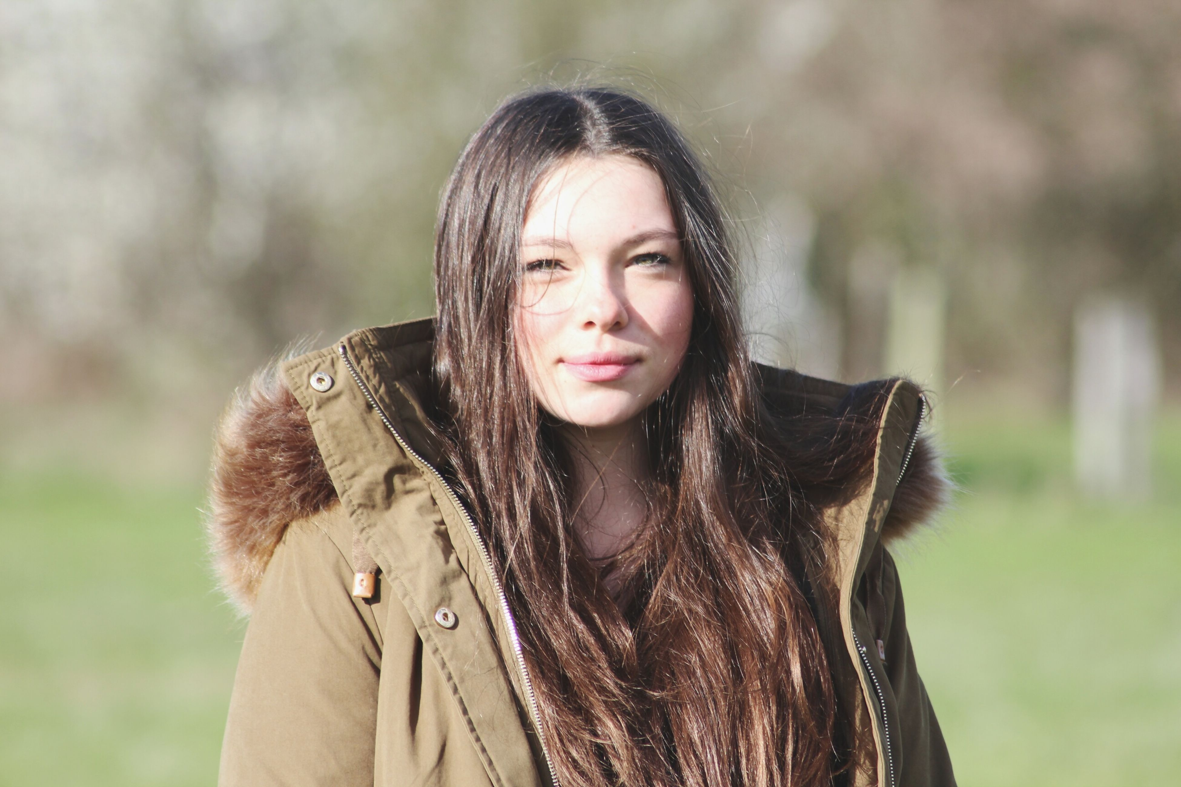 young adult, portrait, young women, person, looking at camera, long hair, front view, smiling, lifestyles, focus on foreground, leisure activity, casual clothing, waist up, happiness, standing, headshot, brown hair