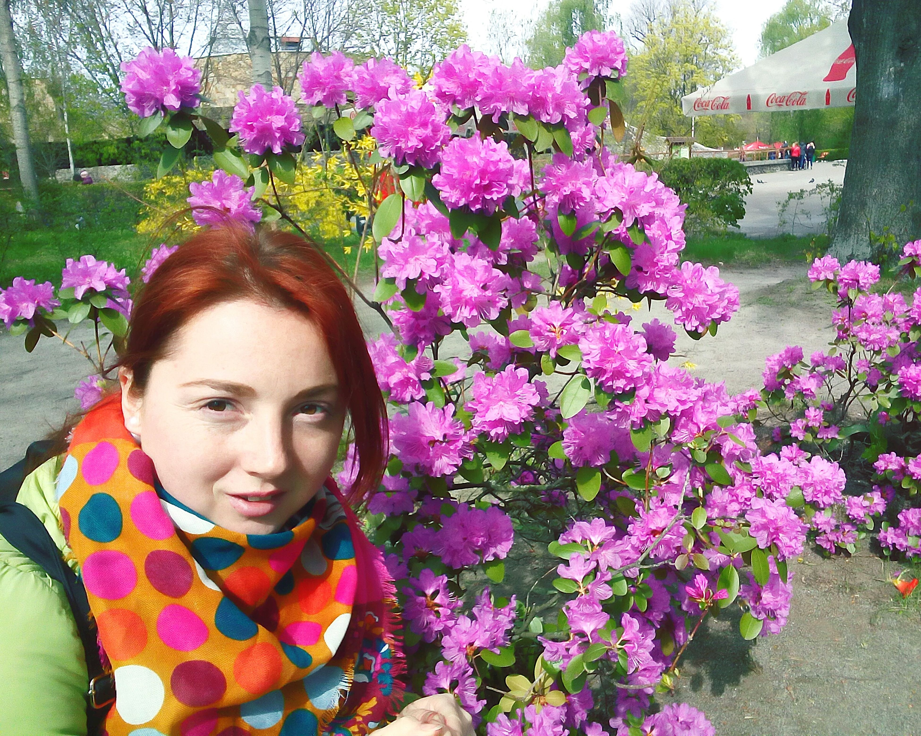 flower, pink color, one person, beautiful woman, front view, beauty, nature, adults only, outdoors, real people, only women, close-up, beauty in nature, freshness, adult, day, one woman only, people, young adult