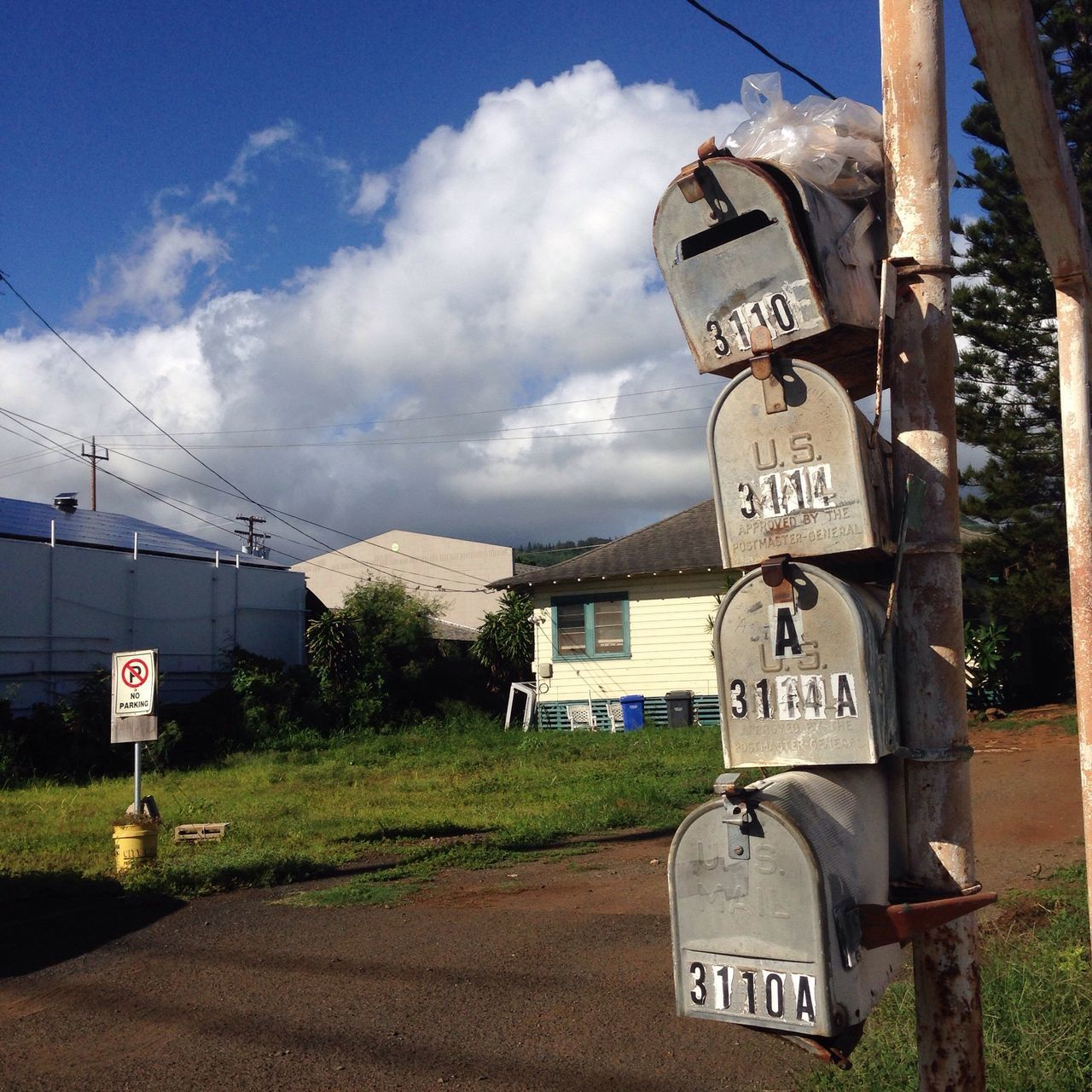 Mailbox Communication Sky Text Cloud - Sky Guidance Day Road Sign Outdoors No People Speed Limit Sign Architecture Nature