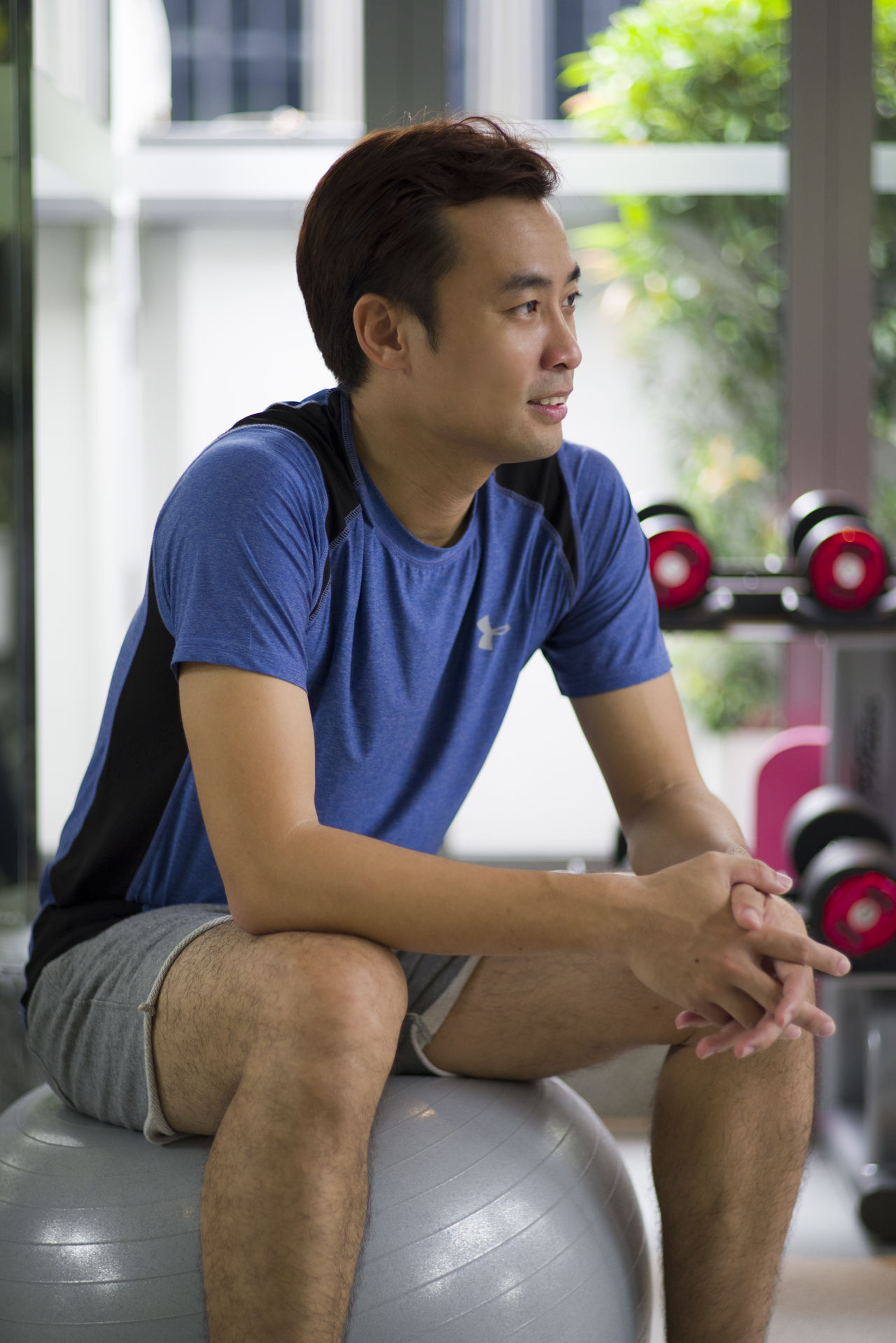 Shot of a young man resting after his workout. Active Adult Athlete Break Confidence  Fitness Gym Handsome Healthy Healthy Lifestyle Lifestyles Looking Male Man Person Portrait Resting Sitting Sport Sports Sportwear Training Wellbeing Workout Young Adult