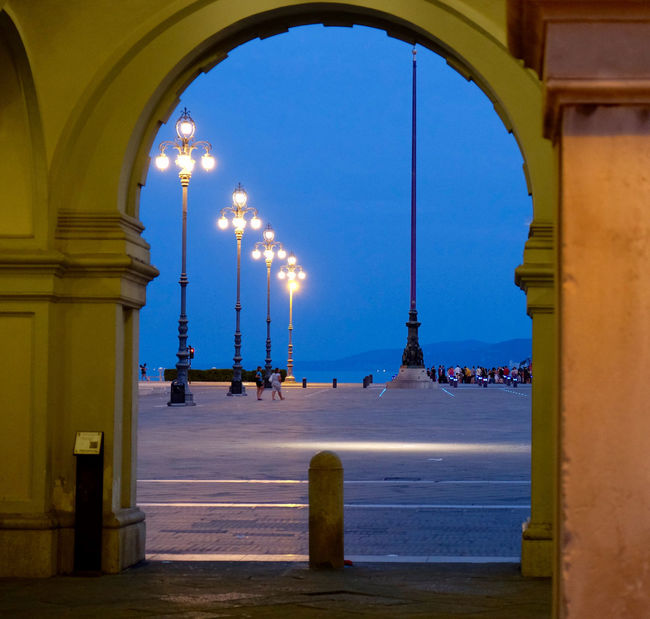 Arch Arched Architecture Art, Drawing, Creativity Blue Column Day Illuminated Italy Italy Holidays Lamp Post Night Night Photography Night View Poster Poster Art Square Squaready Squareinstapic Street Light Tall Travel Traveling Trieste TriesteSocial