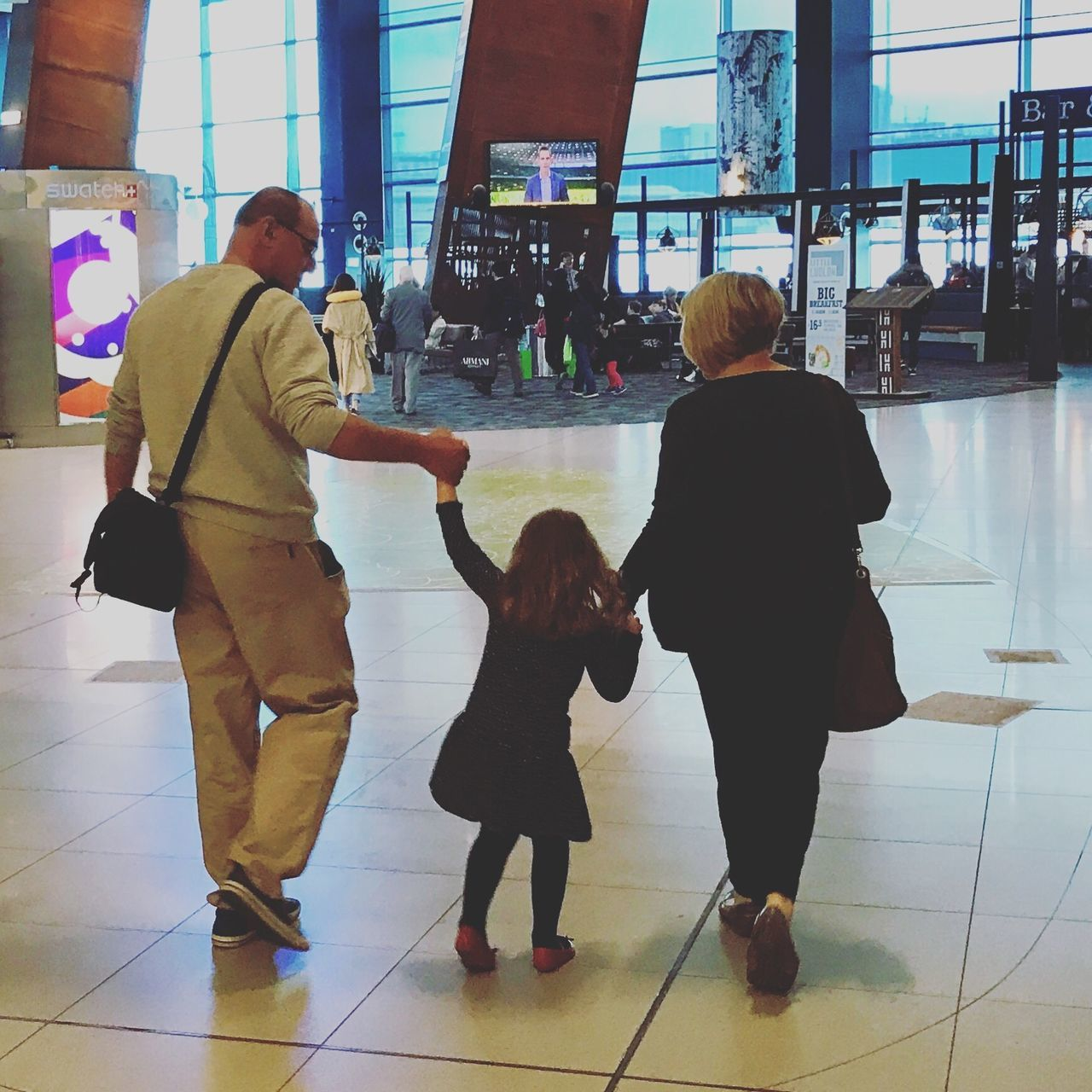 Let's Go. Together. Travelling / Airport Full Length Real People Togetherness Indoors  Casual Clothing Women Men Lifestyles Day Standing Built Structure Childhood Architecture Adult People Adults Only Airport Travel