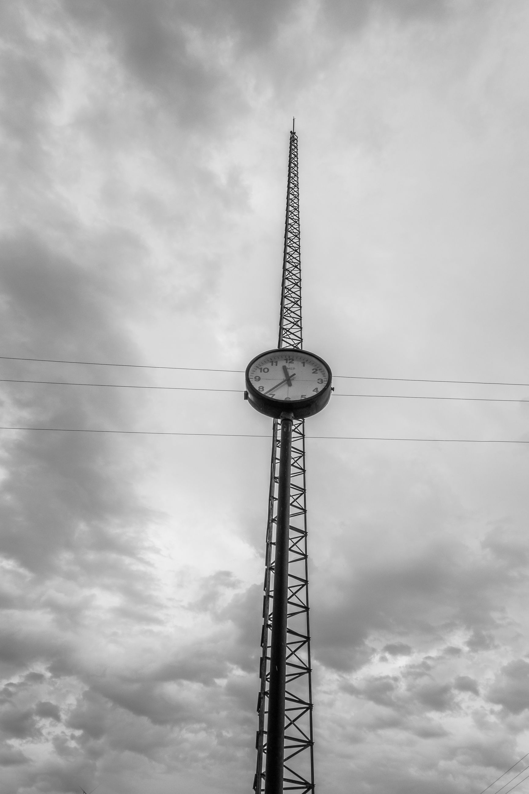 low angle view, sky, cloud - sky, cloudy, tall - high, bird, silhouette, communication, cloud, amusement park, animal themes, animals in the wild, built structure, amusement park ride, outdoors, flying, tower, overcast, dusk, communications tower