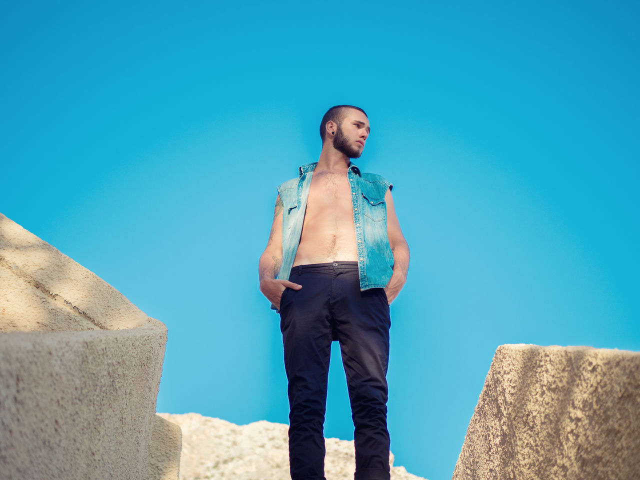 real people, young adult, leisure activity, young men, one person, lifestyles, front view, standing, casual clothing, outdoors, mid adult men, full length, low angle view, blue, day, young women, shirtless, clear sky, architecture, sky, nature
