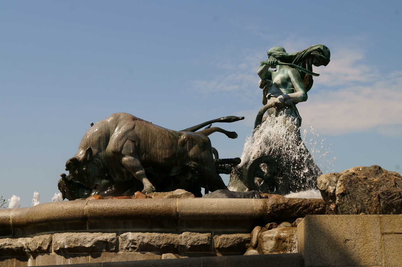 statue, sculpture, art and craft, fountain, low angle view, human representation, creativity, no people, outdoors, day, sky, nature, mammal, gargoyle