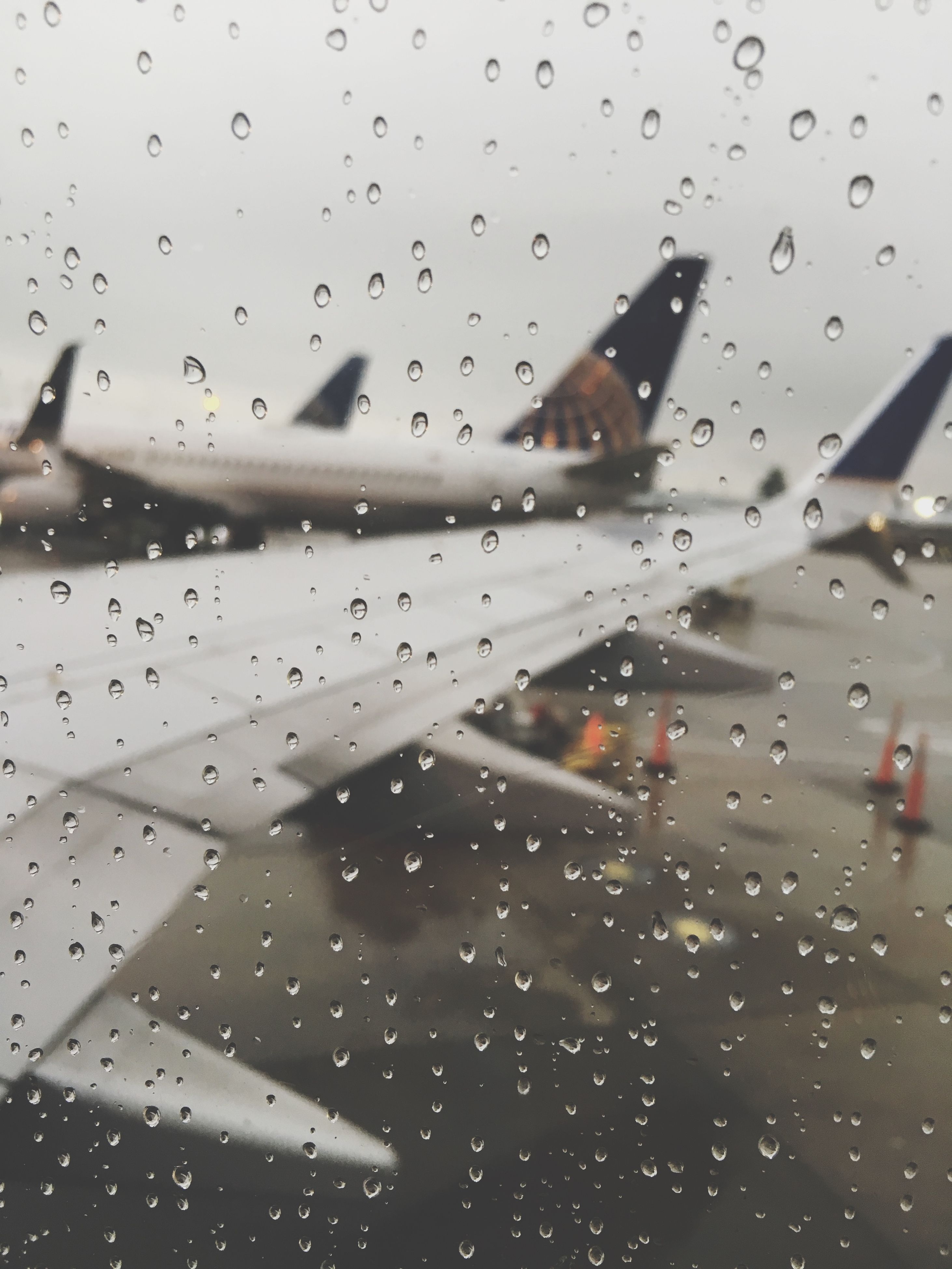 drop, transportation, window, mode of transport, indoors, wet, transparent, glass - material, airplane, rain, vehicle interior, car, air vehicle, backgrounds, raindrop, weather, full frame, windshield, travel, water
