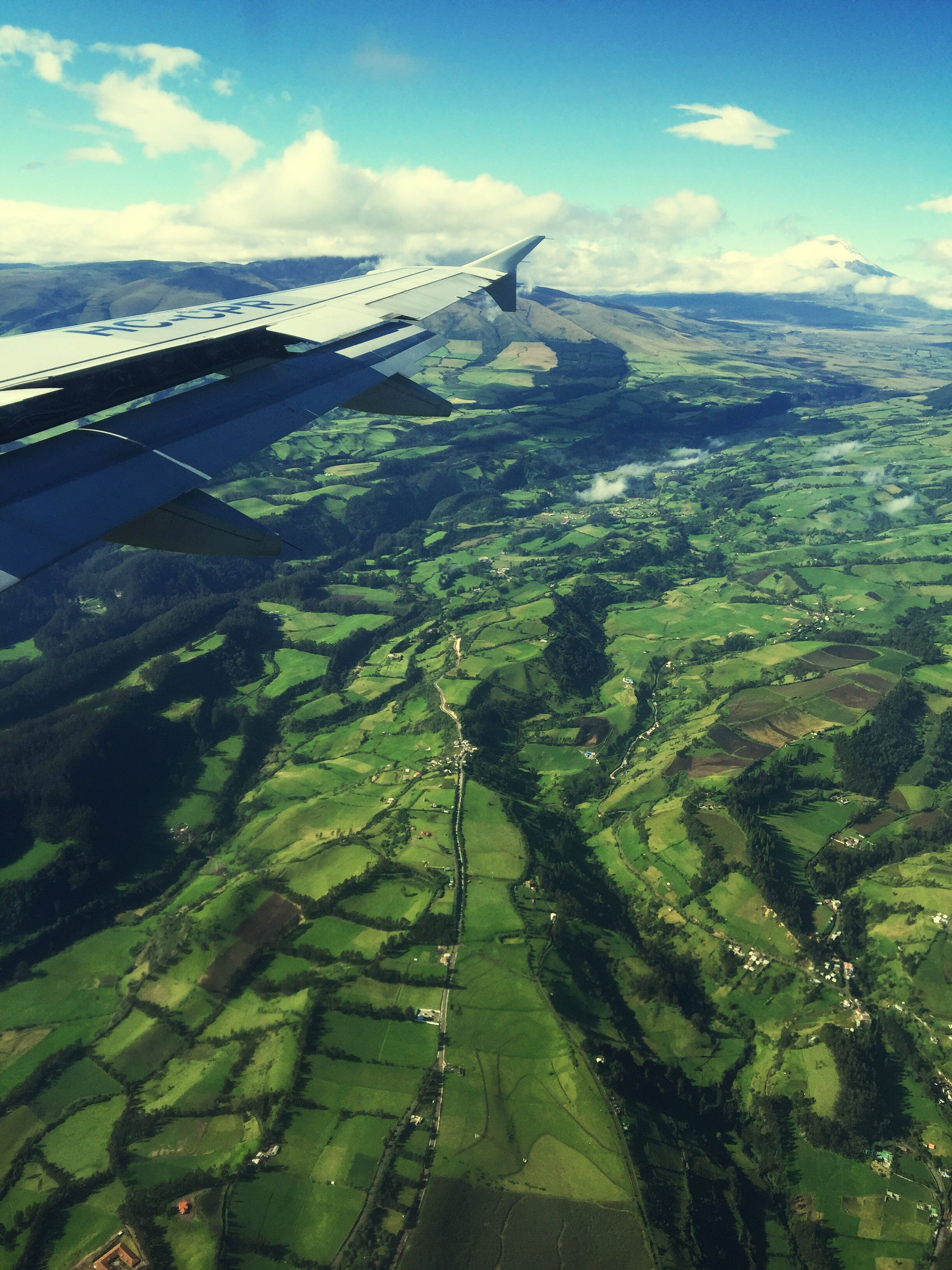 aerial view, mountain, landscape, transportation, scenics, sky, tranquil scene, beauty in nature, tranquility, nature, green color, high angle view, mode of transport, day, mountain range, travel, cloud - sky, idyllic, cloud, airplane