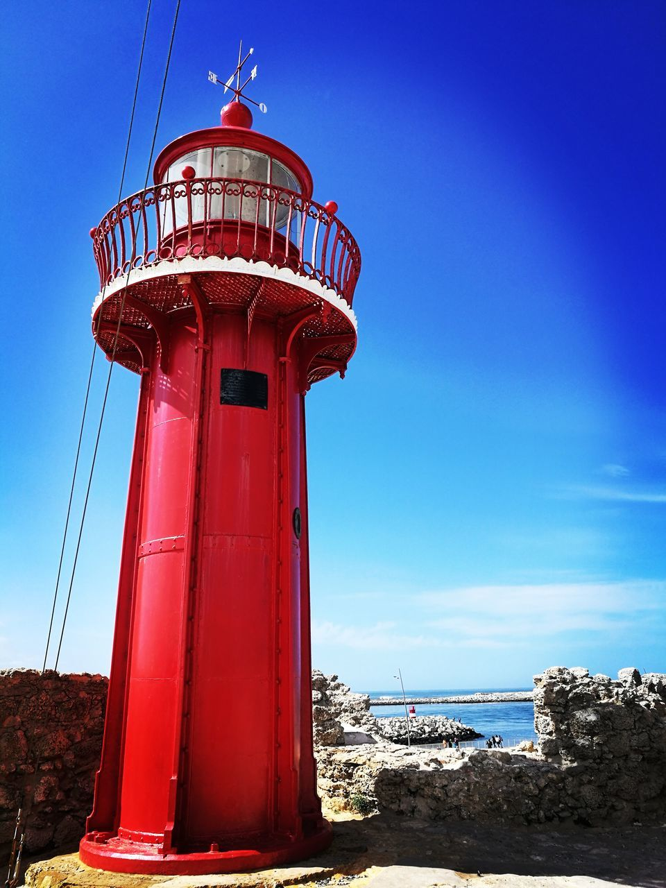 safety, protection, lighthouse, security, sky, guidance, day, architecture, direction, sea, red, built structure, no people, outdoors, blue, nature, lookout tower, building exterior, water