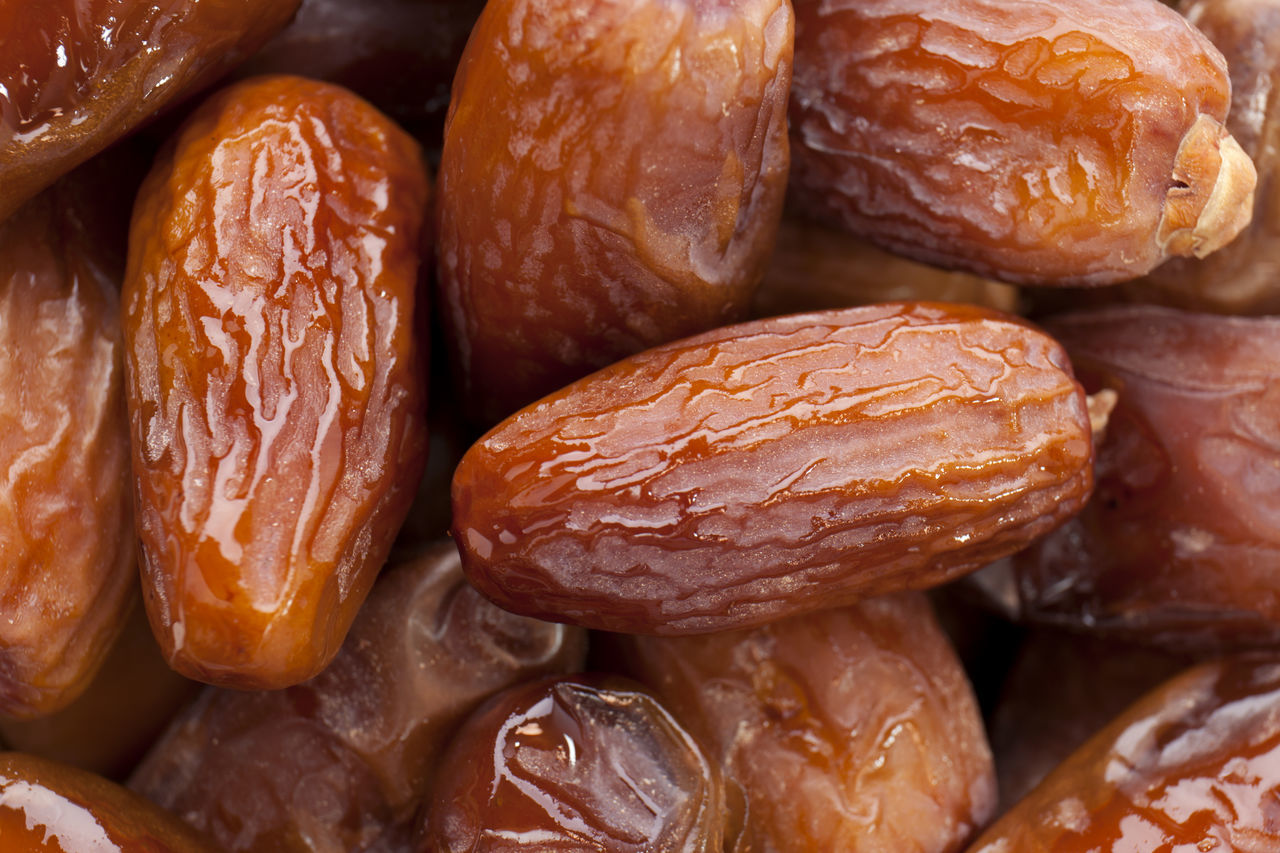 Date Fruit Backgrounds Brown Close-up Color Image Date Fruit Day Dried Fruit Focus On Foreground Food Food And Drink Food Background Freshness Fruit Full Frame Healthy Eating Indoors  Ingredient No People Photography Ready-to-eat Still Life Studio Shot Sweet Food White Background