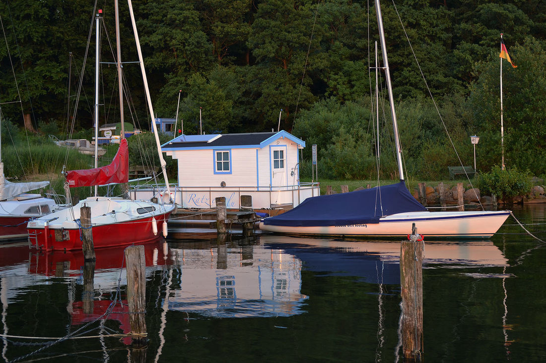 Boat Calm Camping Place Day Fishing Boat Group Of Objects Harbor Lake Ratzeburg Mode Of Transport Nautical Vessel No People Non-urban Scene Reflection Scenics Standing Water Tourism Tranquility Transportation Tree Water Waterfront