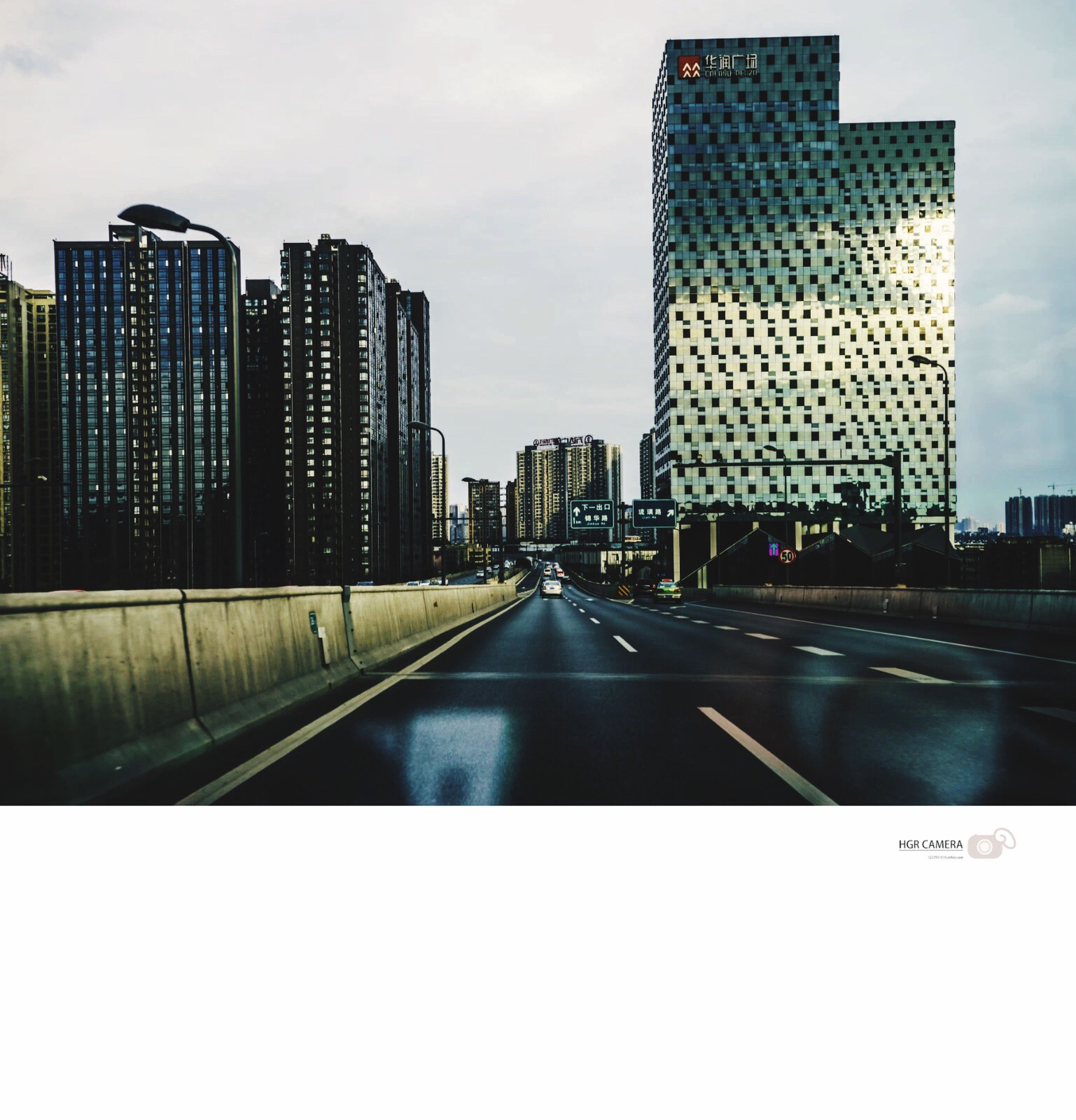 building exterior, architecture, city, built structure, skyscraper, transportation, office building, modern, the way forward, sky, tall - high, tower, diminishing perspective, road, street, car, building, vanishing point, cityscape, city life