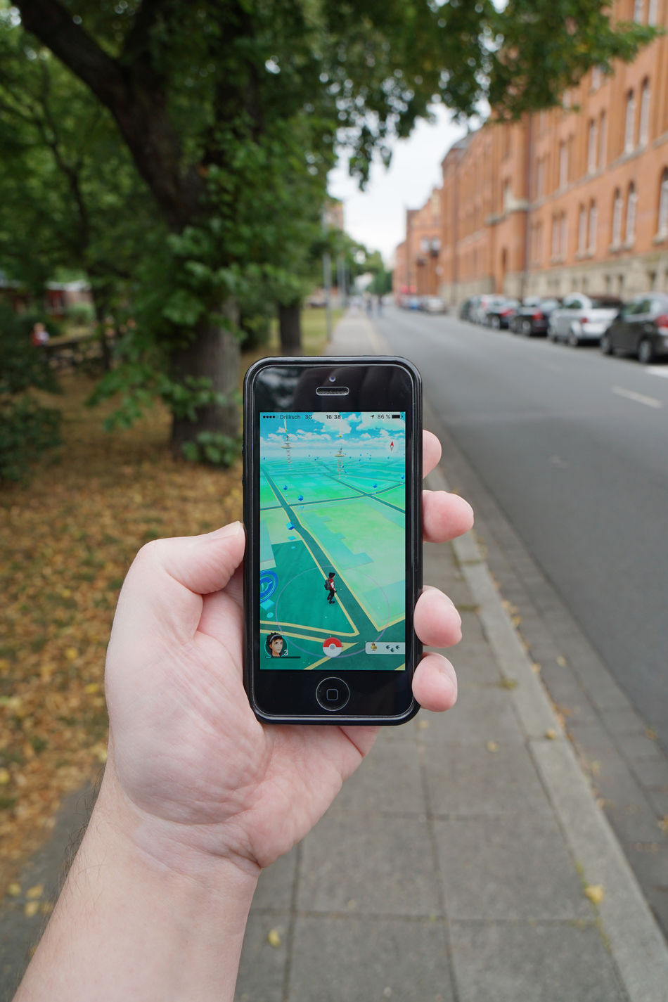 App Augmented Reality Day Game Holding Hype IPhone Leisure Activity Lifestyles Map Mobile Person Personal Perspective Play Player Pokemon Go Pokémon POV Sidewalk Smartphone Street Trend Unrecognizable Person