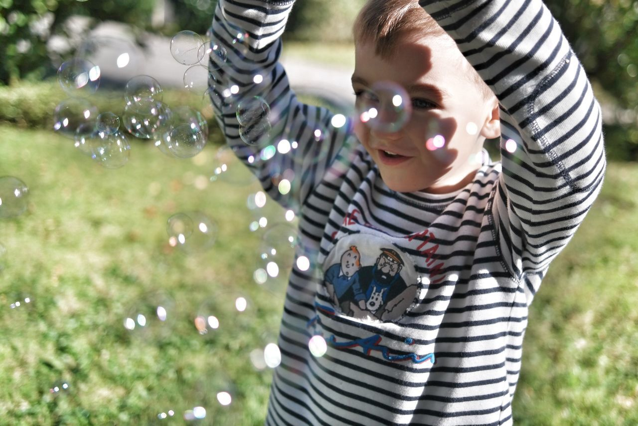 Beautiful stock photos of bubbles, Arms Raised, Boys, Bubble, Casual Clothing