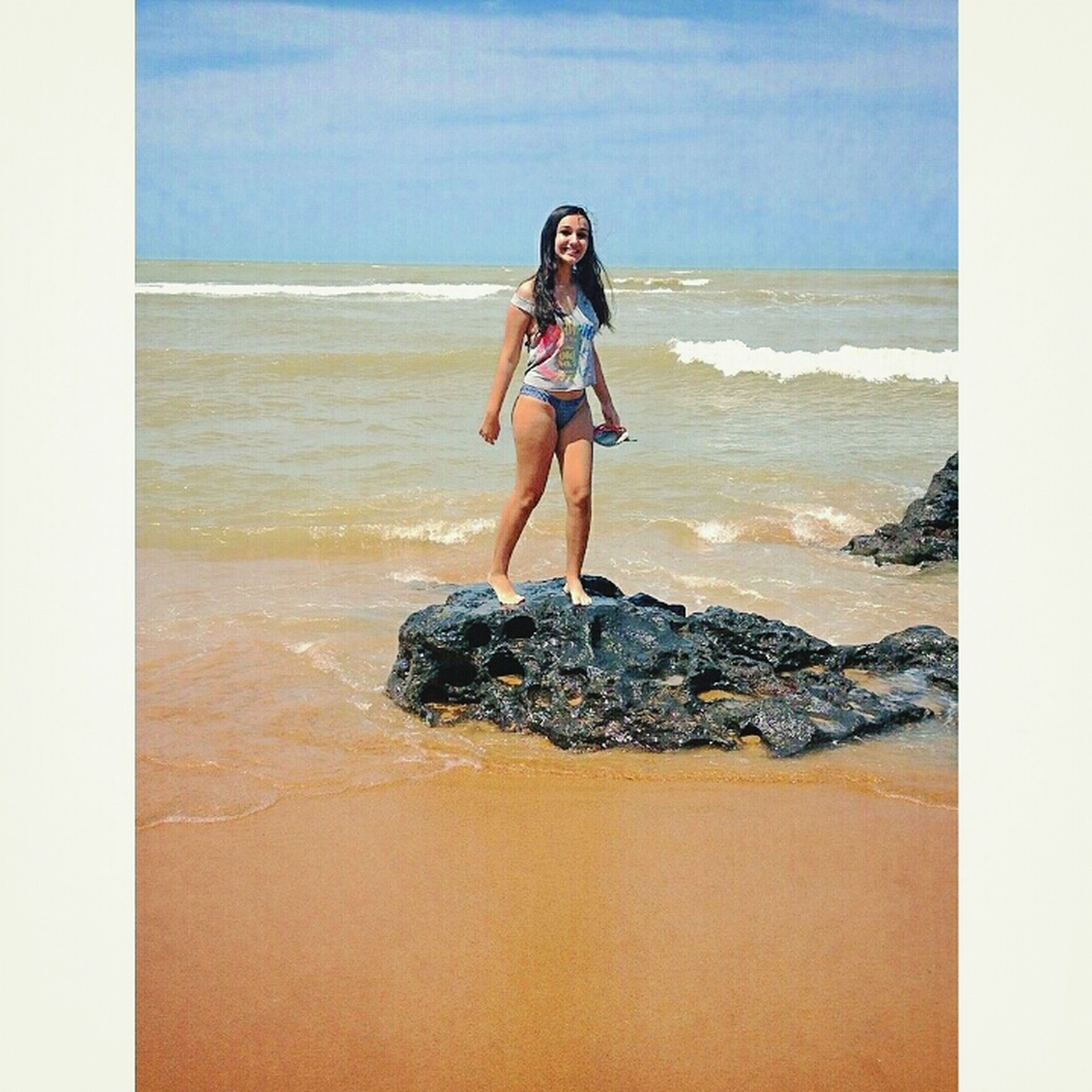 sea, horizon over water, beach, shore, young adult, sky, lifestyles, water, leisure activity, full length, sand, transfer print, person, auto post production filter, scenics, vacations, standing, young women
