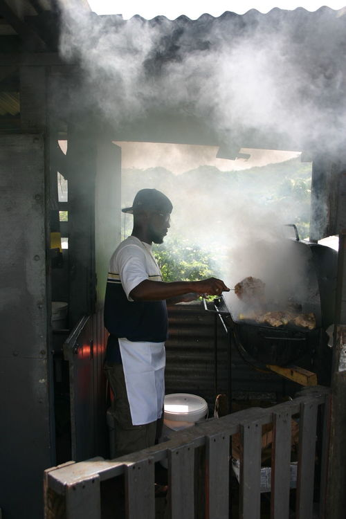 Chef on the grill Jerkchicken On The Grill The Portraitist - The 2016 EyeEm Awards Mouth Watering 🍝🍔🍧🎂 Jerk Chicken Smoked Out Grenada Chef