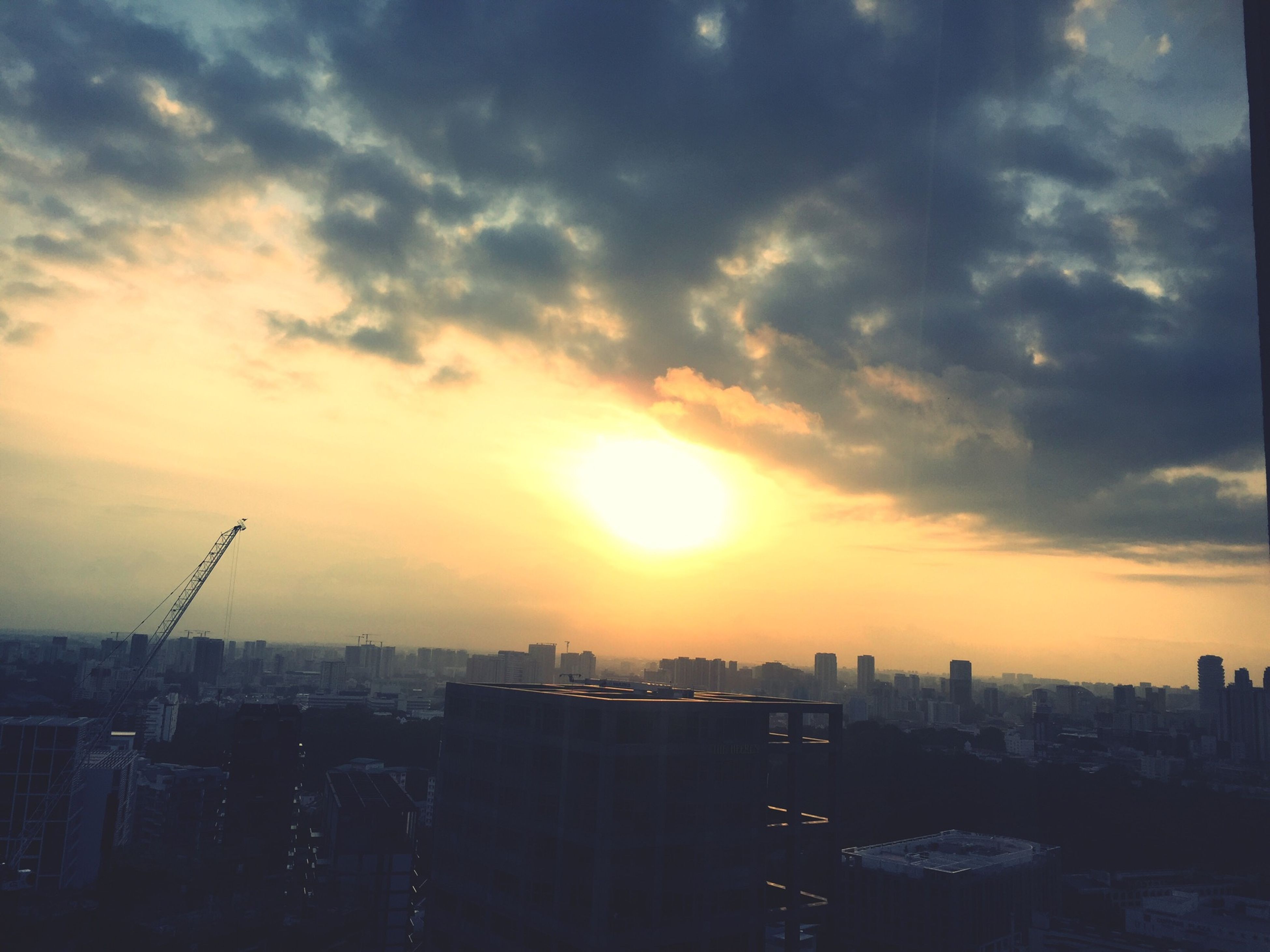 sunset, building exterior, city, cityscape, architecture, built structure, sky, cloud - sky, skyscraper, sun, orange color, crowded, tower, tall - high, residential district, residential building, urban skyline, sunlight, silhouette, city life