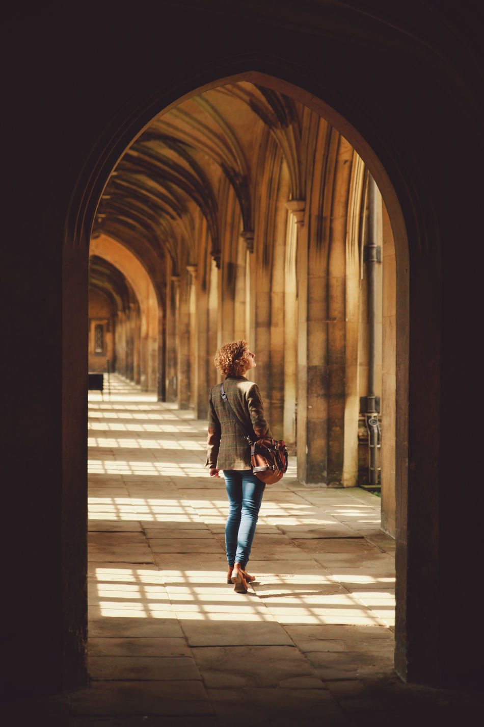 Alone Arch Architectural Column Architecture Archway Built Structure Corridor Countour Curly Hair Front View Full Length Girl Indoors  Leisure Activity Lifestyles Person Rear View Shadow Standing The Way Forward Walking The Portraitist - 2016 EyeEm Awards Feel The Journey 43 Golden Moments People And Places The Secret Spaces