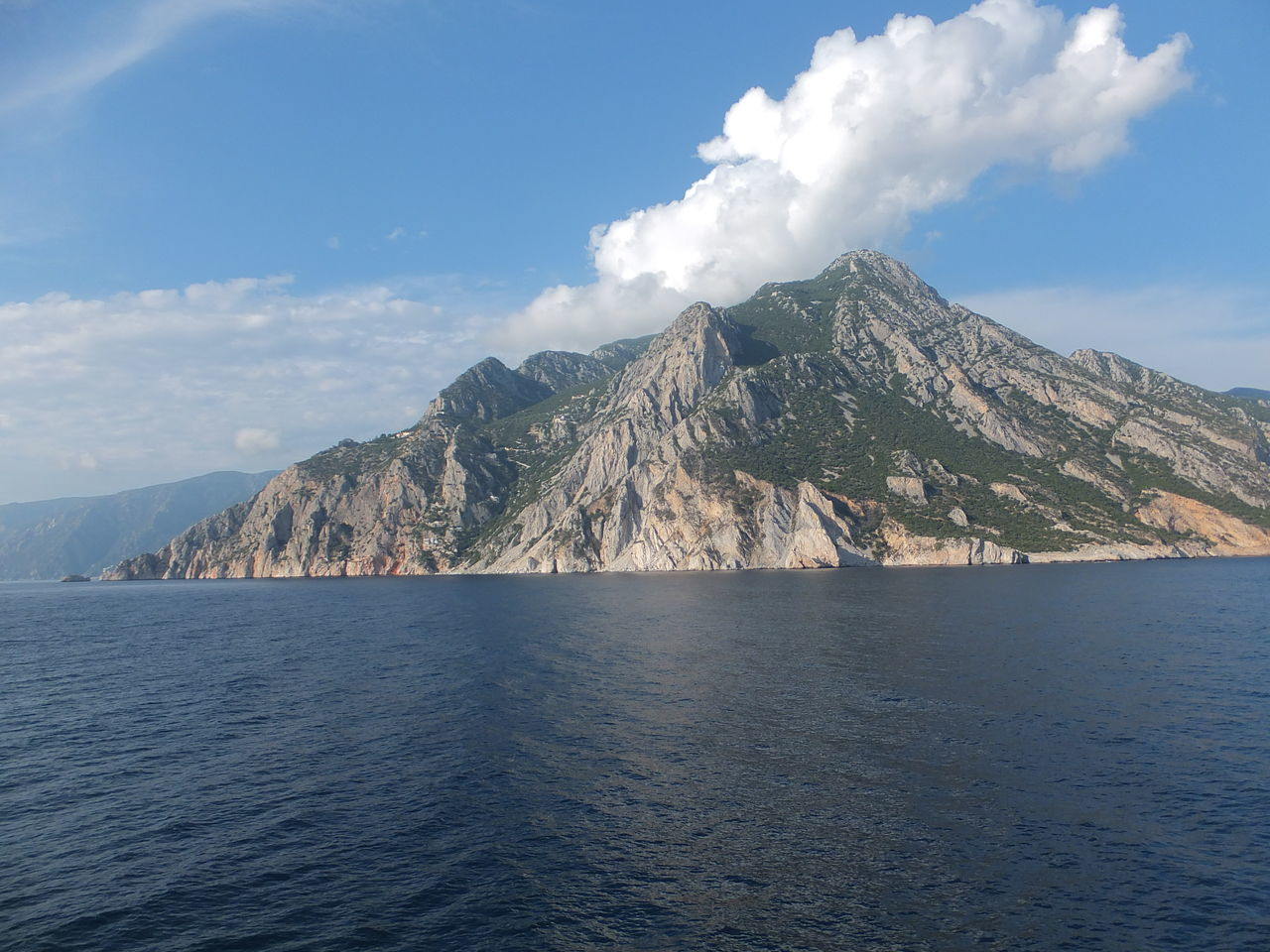 Mount Athos Beauty In Nature Blue Sky White Clouds Cliff Geology Greece Hill Landscape Majestic Mount Athos Mountain Mountain Range Outdoors Physical Geography Religion Remote Ripples Rock Rock Formation Sacred Place Scenics Sea Tranquil Scene Tranquility Voyage Waves