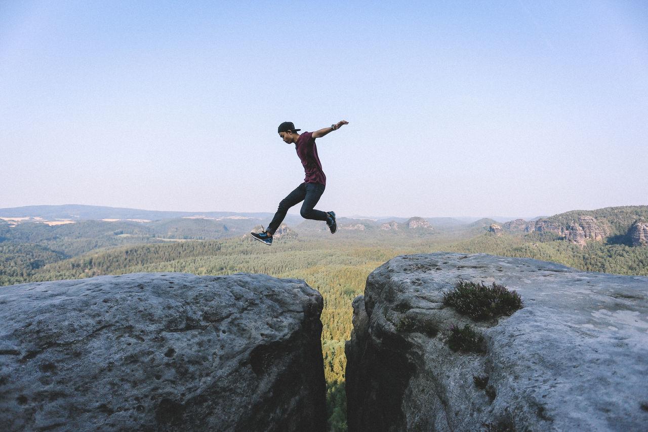 Beautiful stock photos of freedom, full length, jumping, mid-air, skill