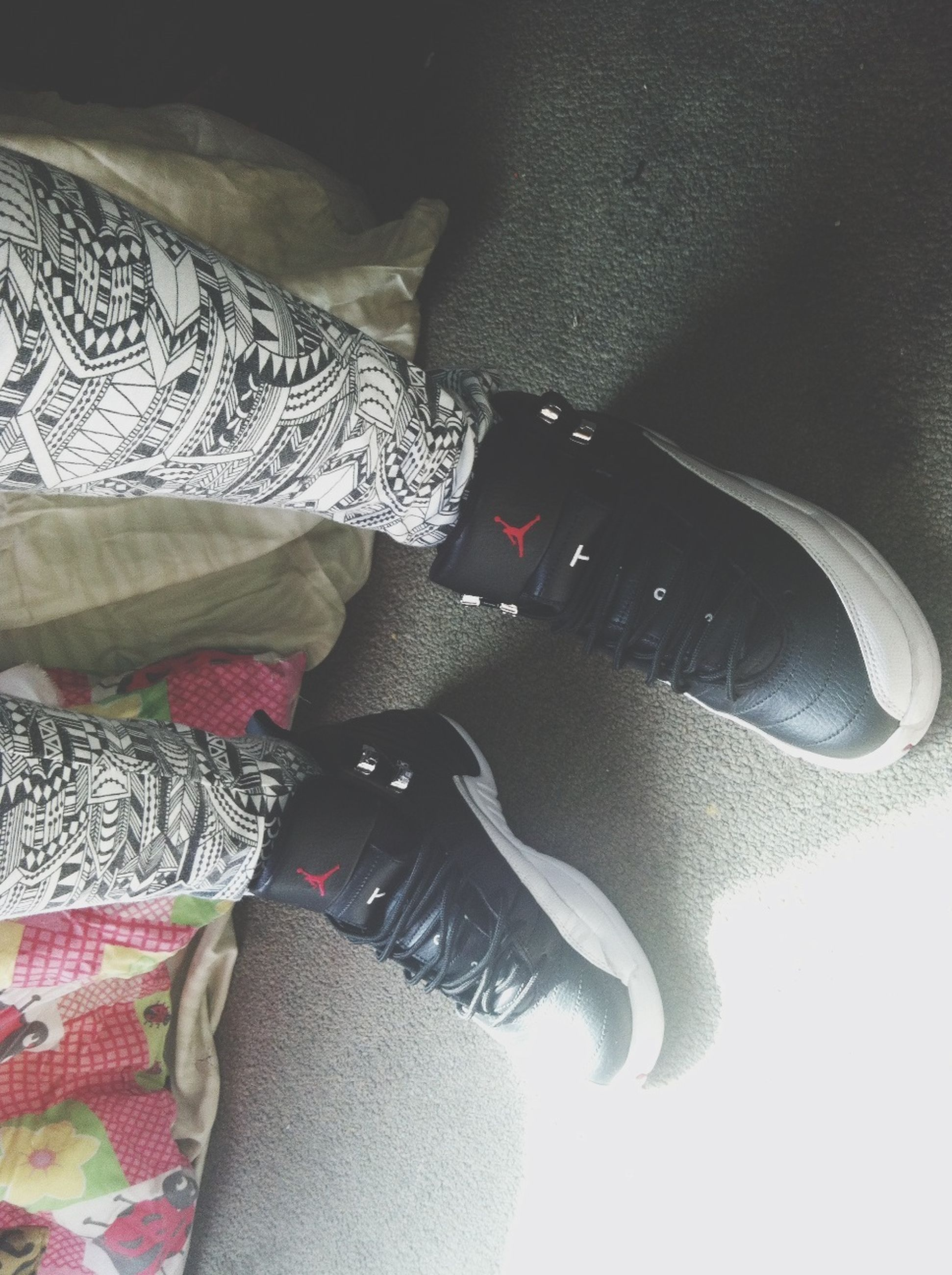 low section, person, shoe, lifestyles, personal perspective, high angle view, footwear, jeans, human foot, leisure activity, standing, indoors, men, casual clothing, fashion, part of