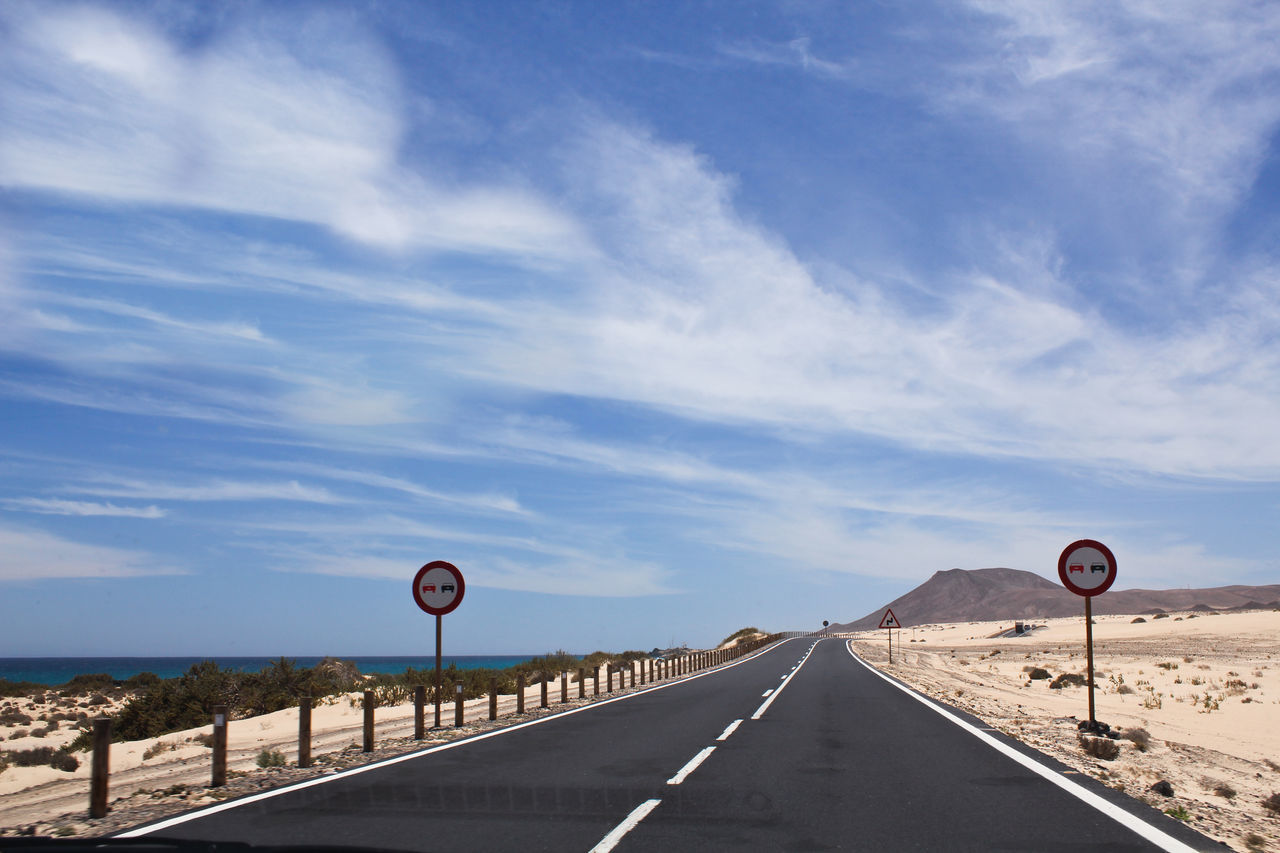 Adventure Beauty In Nature Cloud - Sky Communication Day Empty Road Landscape Nature No People Ocean Road Road Sign Sand Sea Sky Speed Limit Sign Transportation Warning Sign Winding Road
