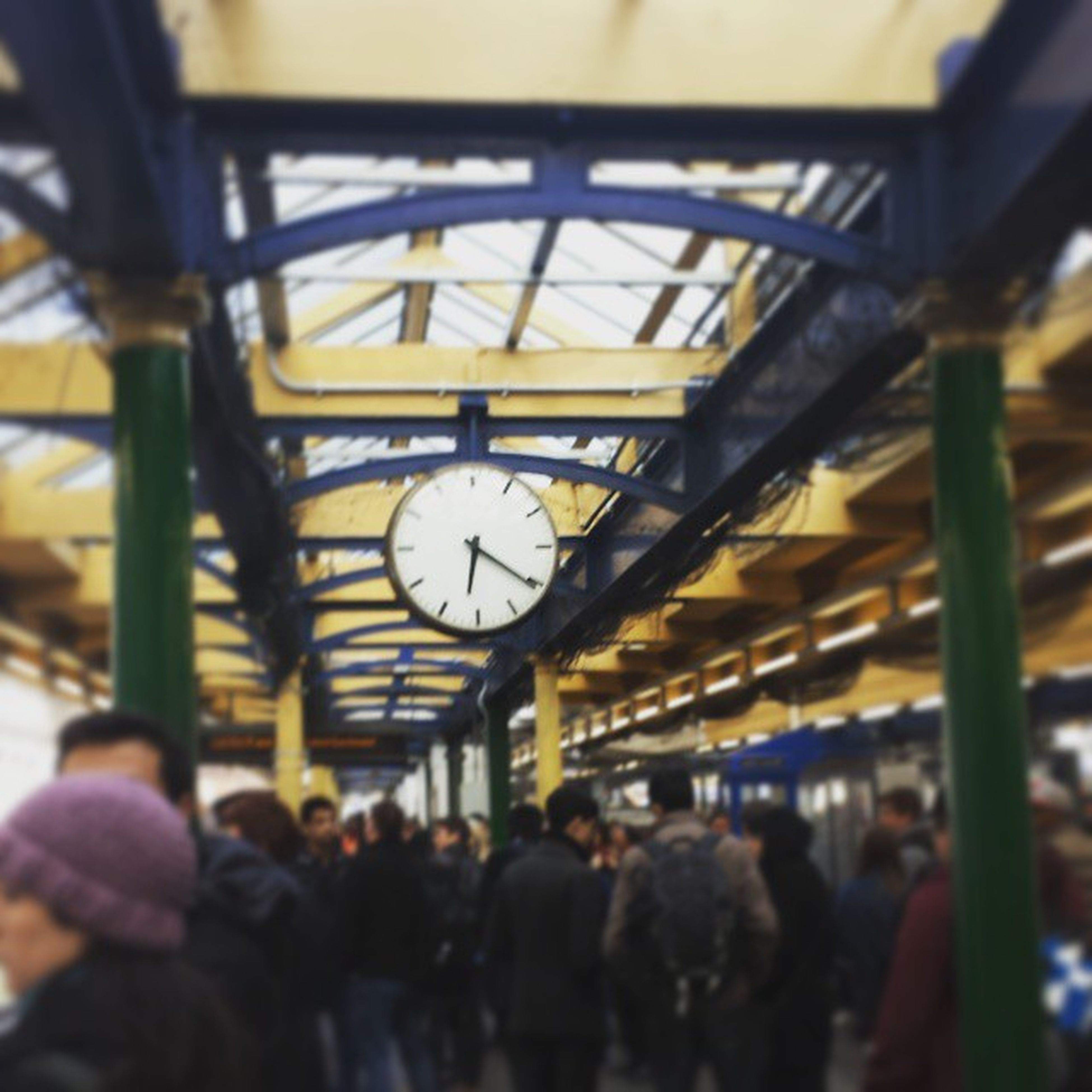 indoors, large group of people, men, person, lifestyles, architecture, built structure, leisure activity, transportation, railroad station, travel, public transportation, city life, ceiling, incidental people, illuminated, walking, shopping mall, rail transportation