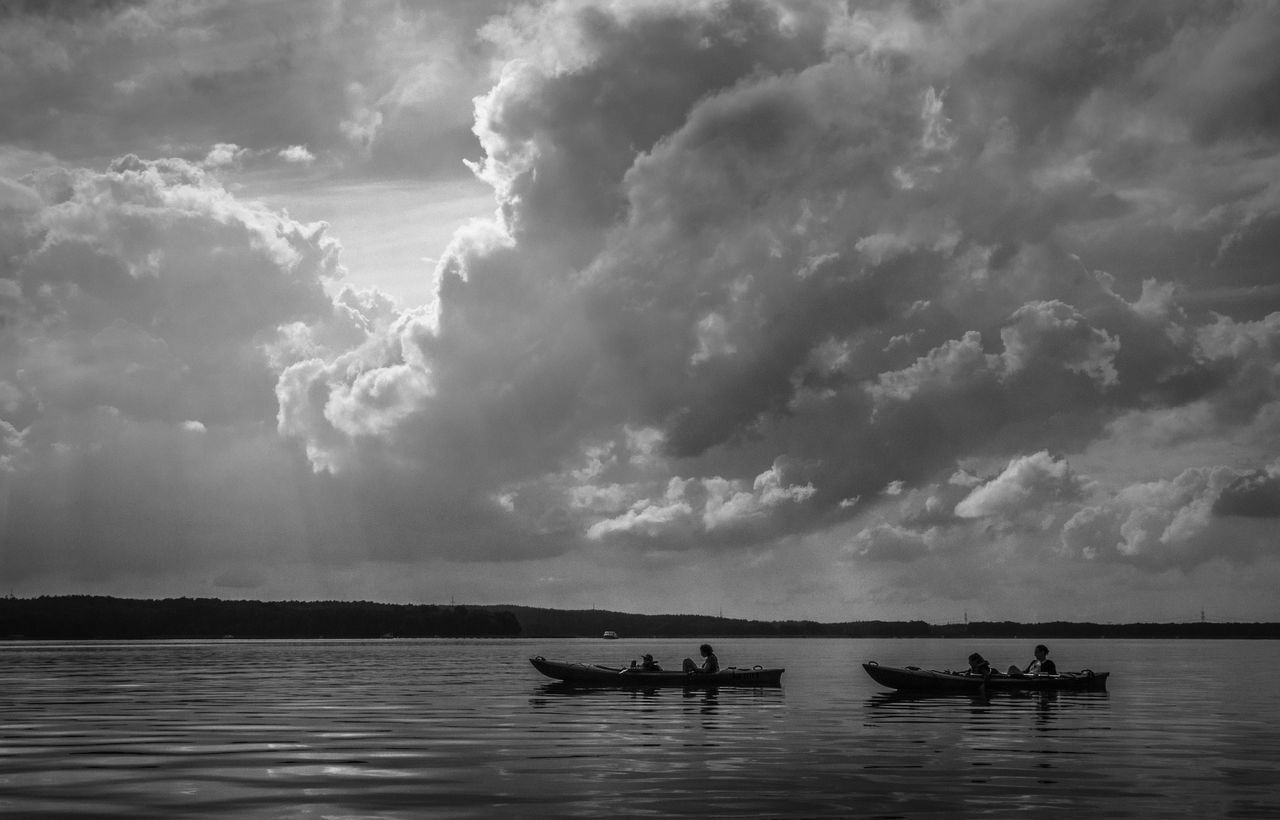 just chill under dramatic sky Activity Beauty In Nature Blackandwhite Boat Chillin Chilling Cloud - Sky Clouds And Sky Contrast Dramatic Sky EyeEm Best Shots EyeEm Best Shots - Black + White Fortheloveofblackandwhite Lake View Landscape Leisure Activity Medium Group Of People Mode Of Transport Nature Overcast Tranquil Scene Vacations Water Weather