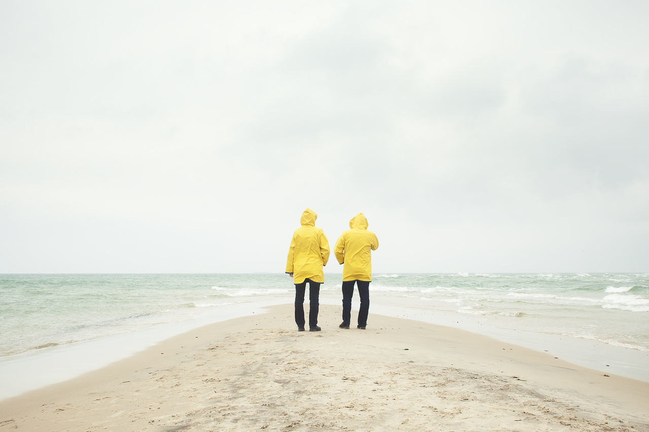 The meeting of two oceans Beach Carefree Pastel Power Couple Denmark Enjoying Life Getting Away From It All Horizon Over Water Ocean Ocean View Pastel Peace And Quiet Peaceful People Raincoat Sand Sea Seascape Shore Vacation Water Wave Yellow Love Without Boundaries #followfriday