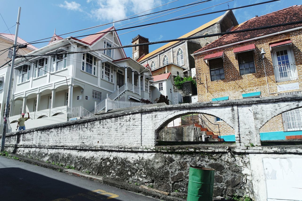 Streets of Grenada, Trinidad Tobago Architecture Building Exterior City Outdoors Built Structure Bridge - Man Made Structure Railing Travel Destinations Sky Day No People Cityscape Fresh 3 EyeEm Best Shots Open Edit Streetphoto_color Streetphotography Street Photography Architecture Vacations Eye4photography