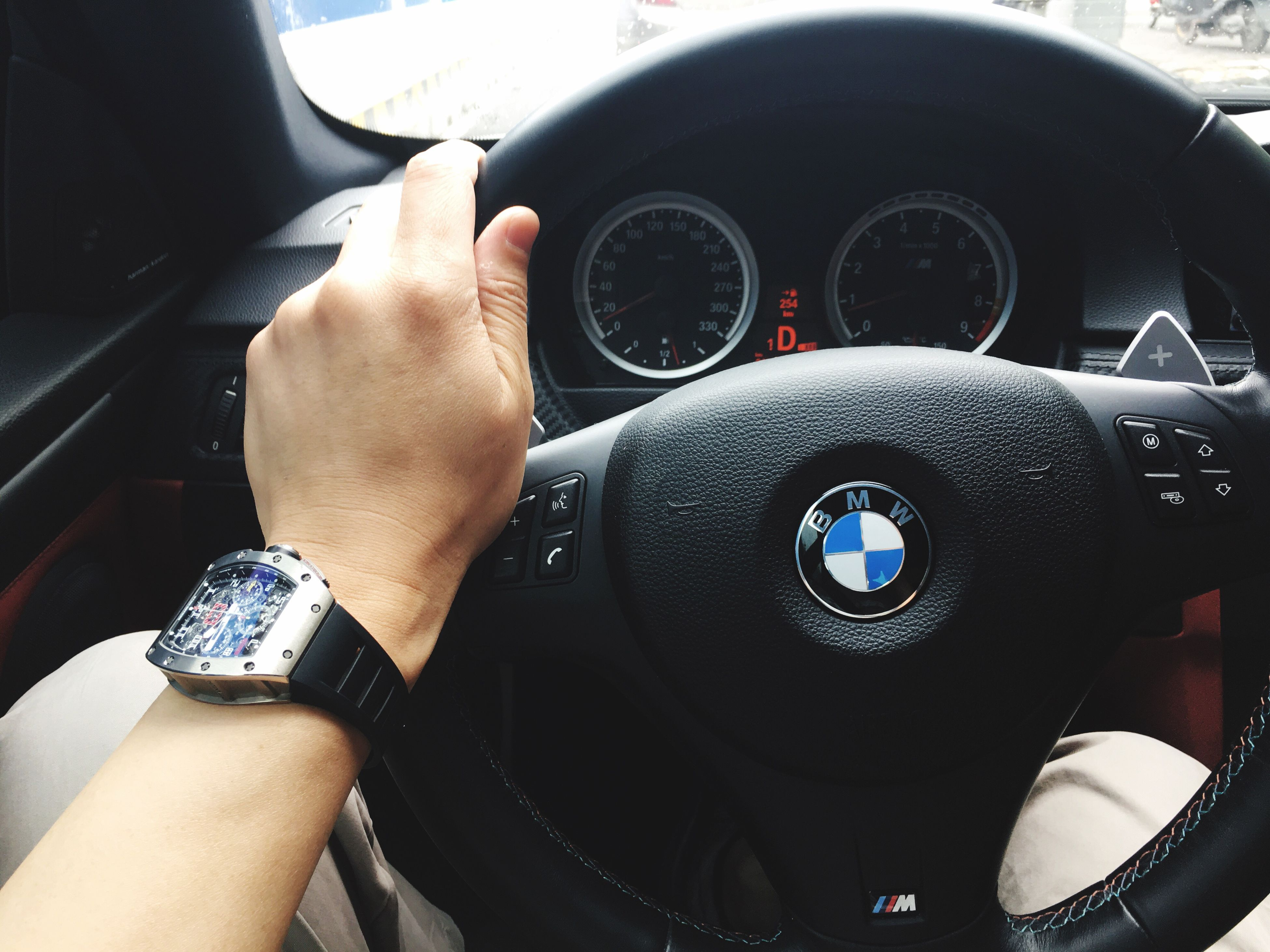 part of, person, transportation, cropped, mode of transport, personal perspective, lifestyles, land vehicle, leisure activity, holding, car, men, low section, technology, travel, vehicle interior