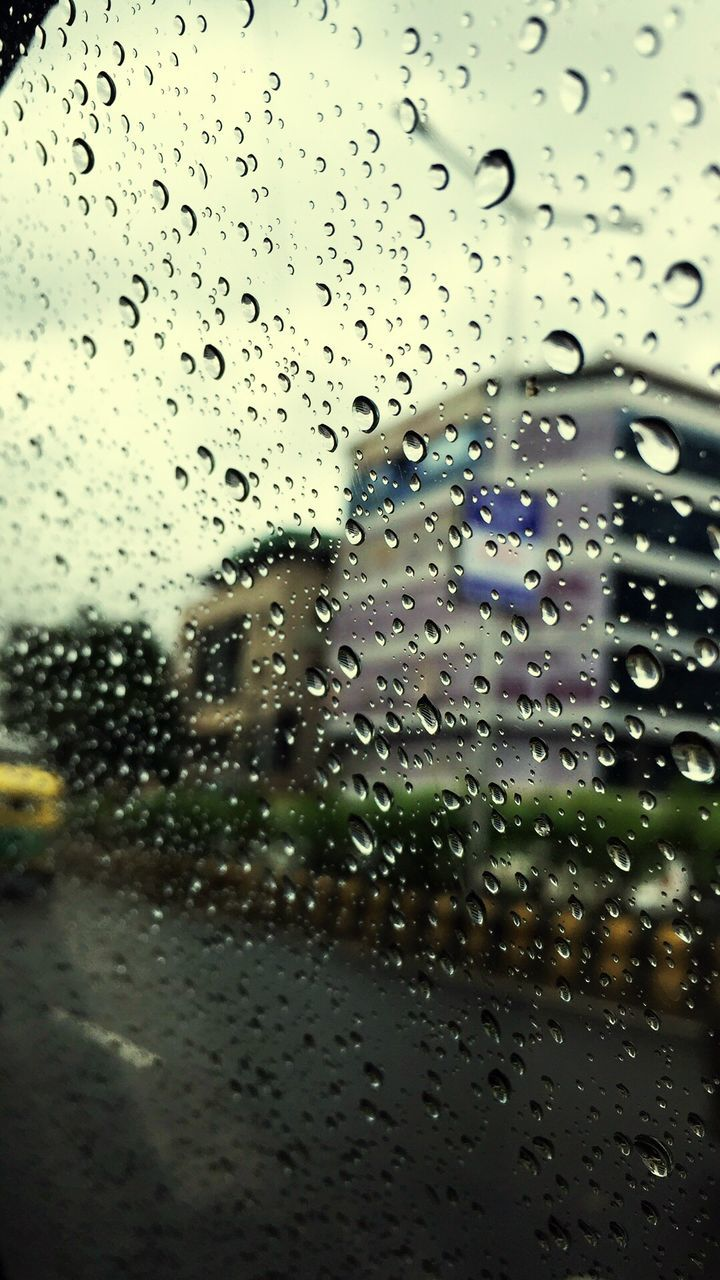 drop, wet, glass - material, transparent, window, water, rain, raindrop, glass, rainy season, water drop, vehicle interior, droplet, weather, no people, indoors, car, land vehicle, close-up, car interior, full frame, focus on foreground, windshield, day, looking through window, backgrounds, sky, nature, freshness, airplane wing
